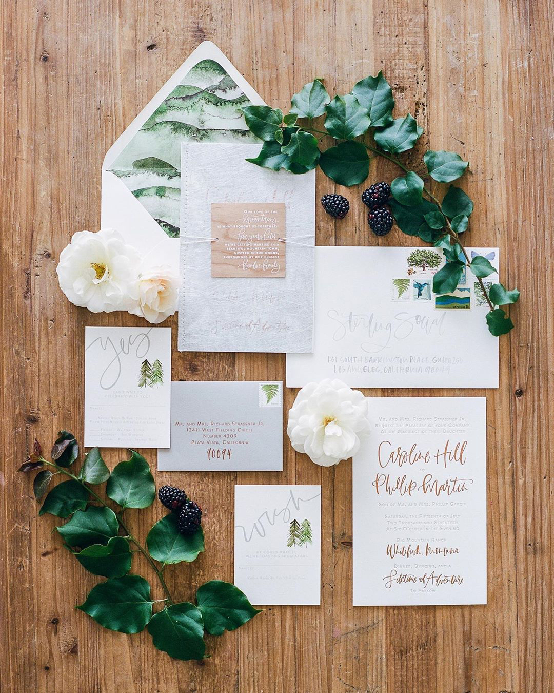 rustic wedding invitations with greenery and creative lettering