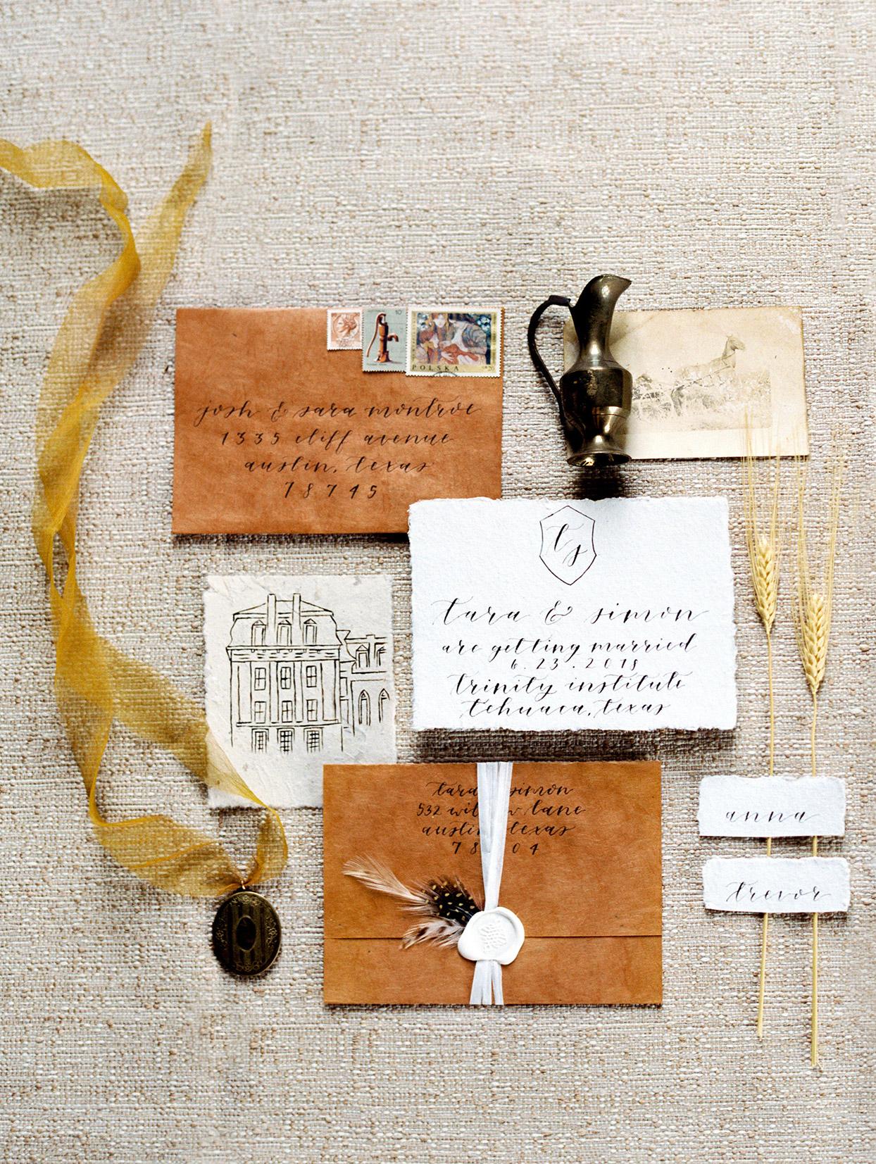 rustic wedding invitations bark, feathers, and wax seal
