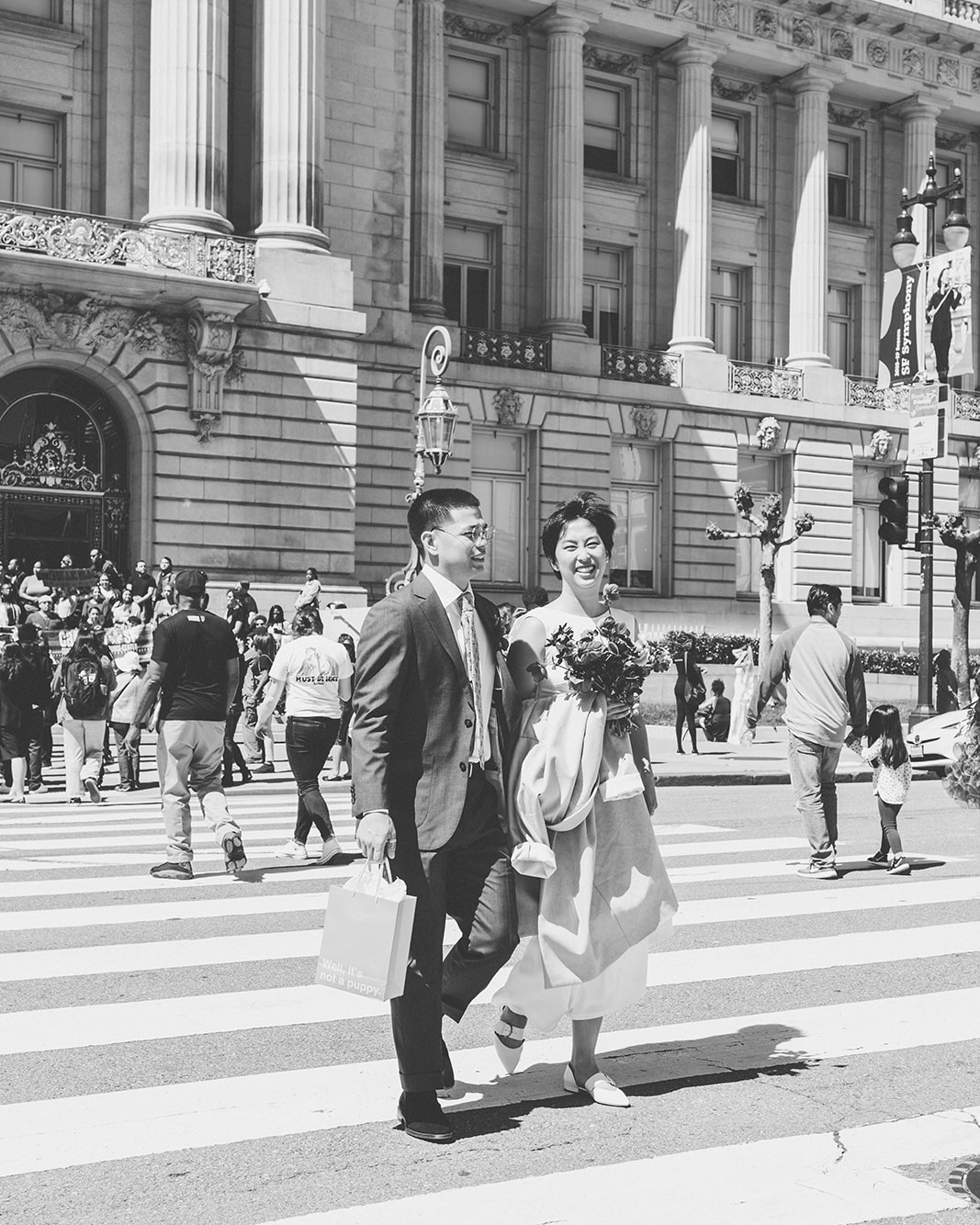 bride groom walking crosswalk historical building