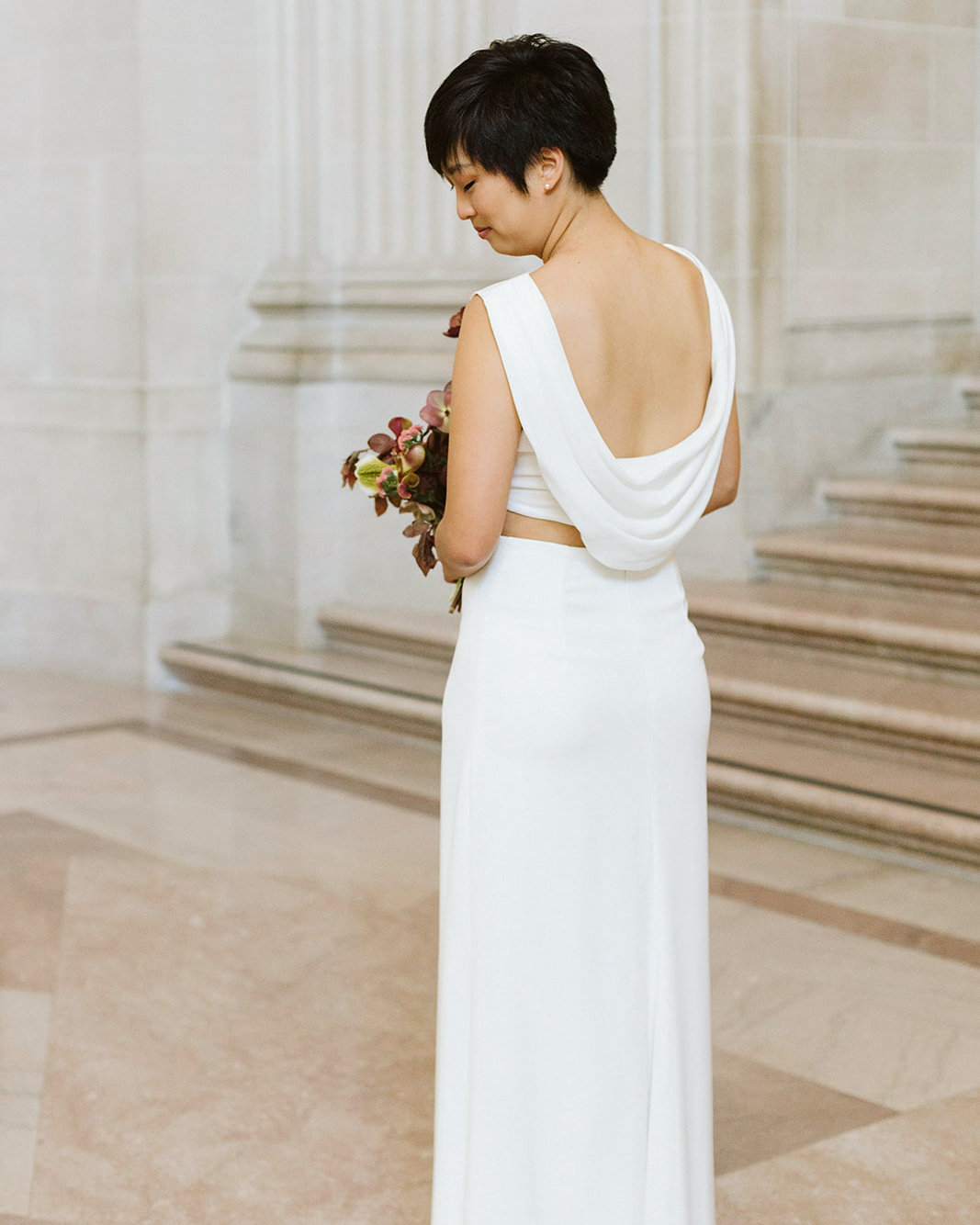 bride back pose 2-piece open back wedding dress