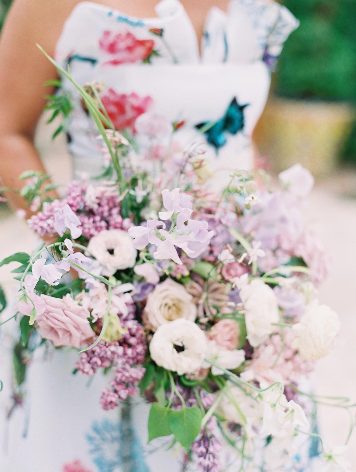 raina and salih pink and purple wedding bouquet