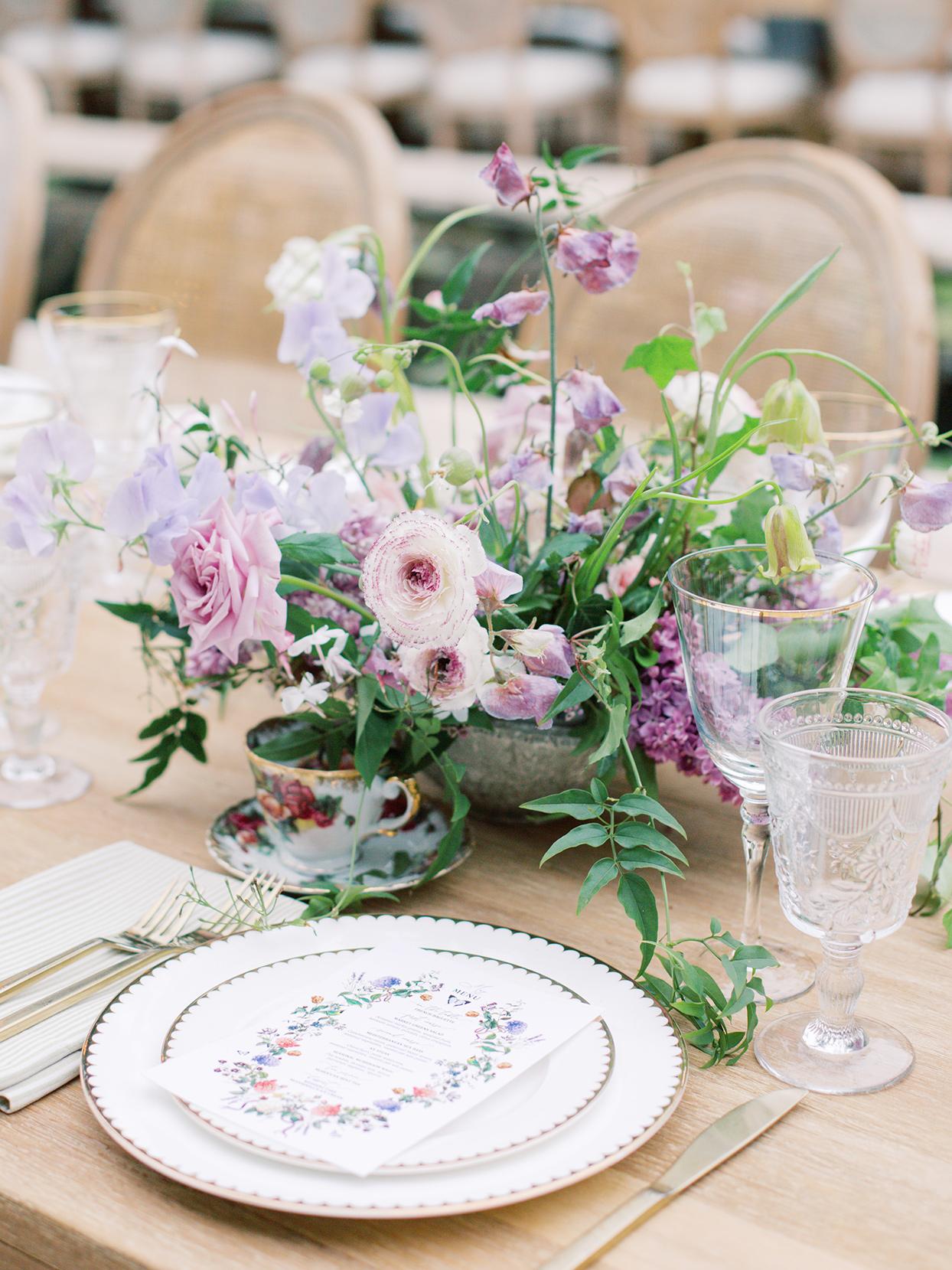 raina salih wedding centerpiece with lavender bouquet