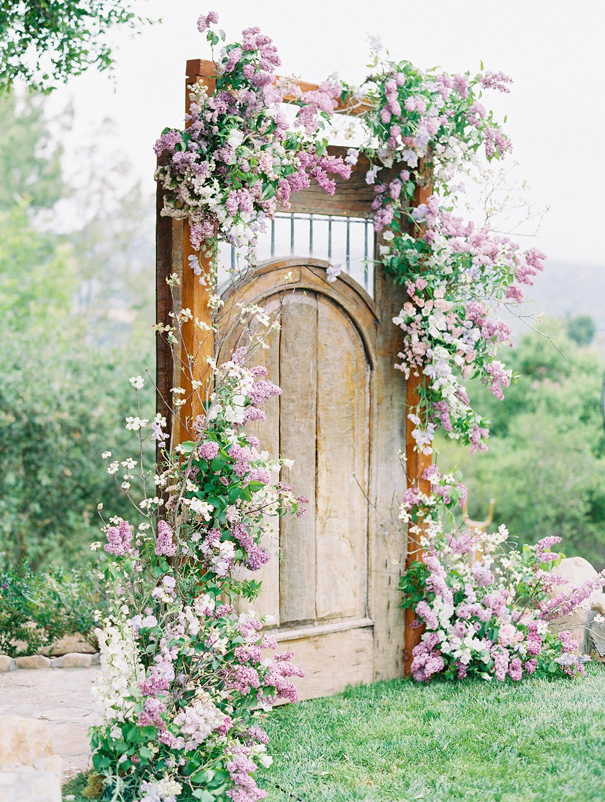 raina salih wedding ceremony door with flowers