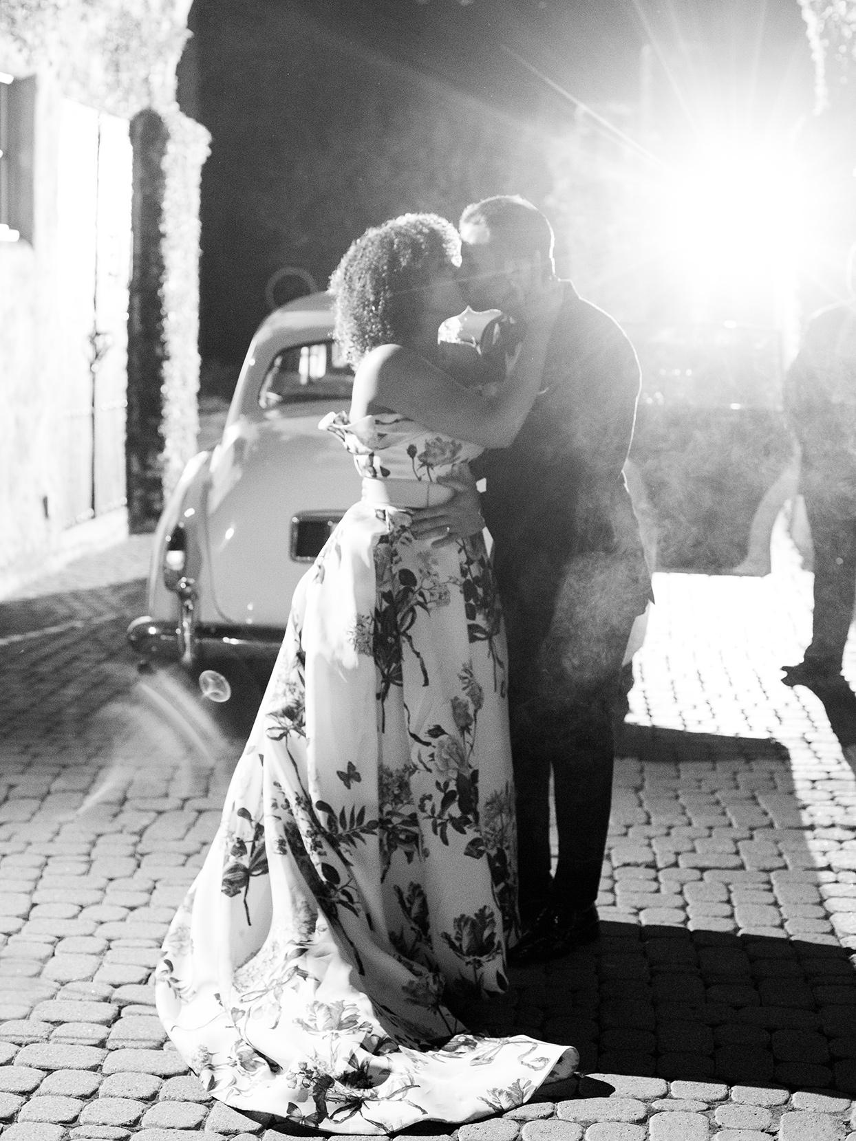 raina salih wedding couple kiss in front of car