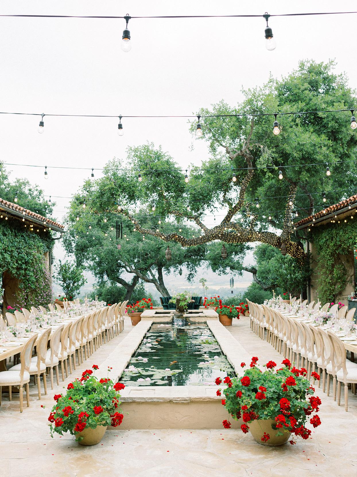 raina salih wedding reception long tables and lily pond