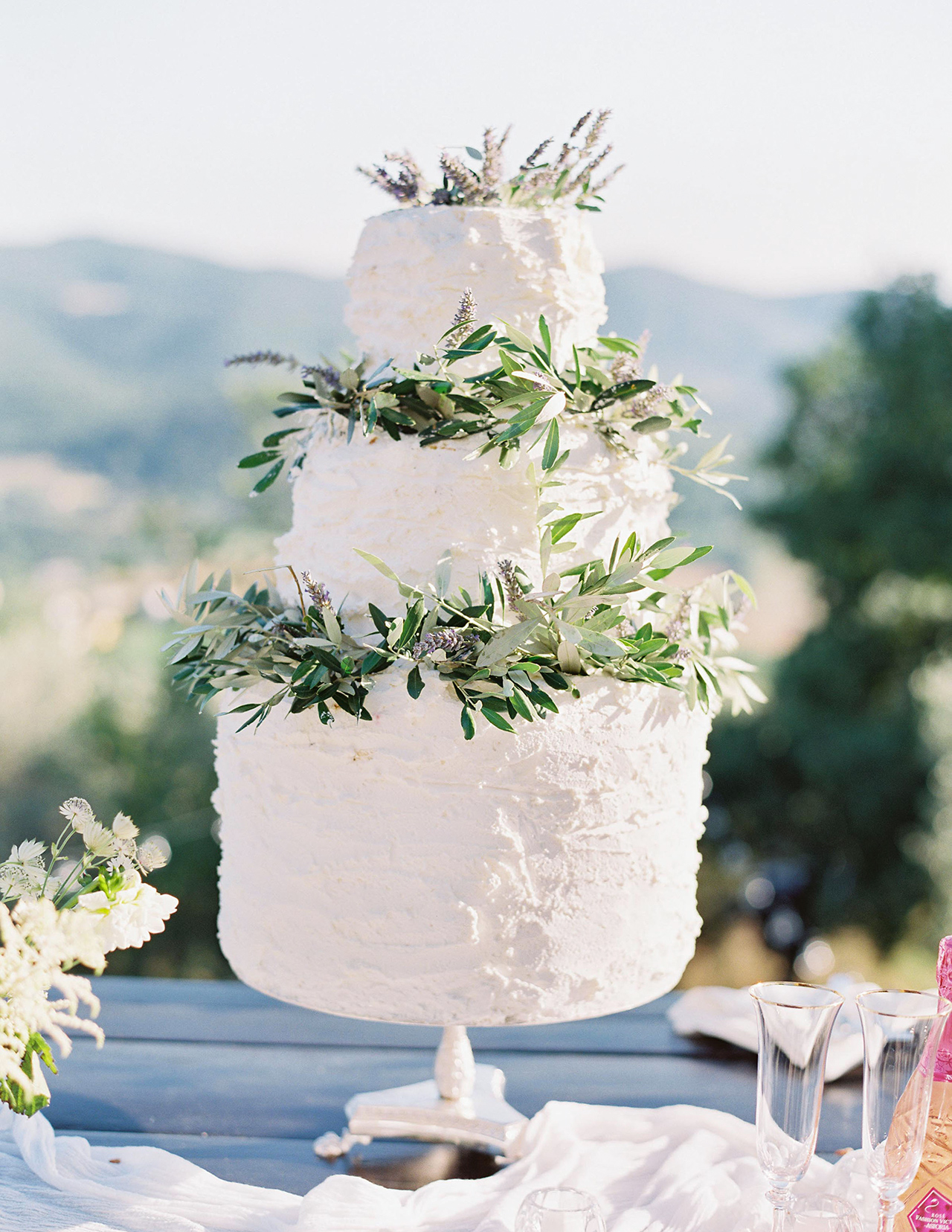 three tier white wedding cake olive branch layers