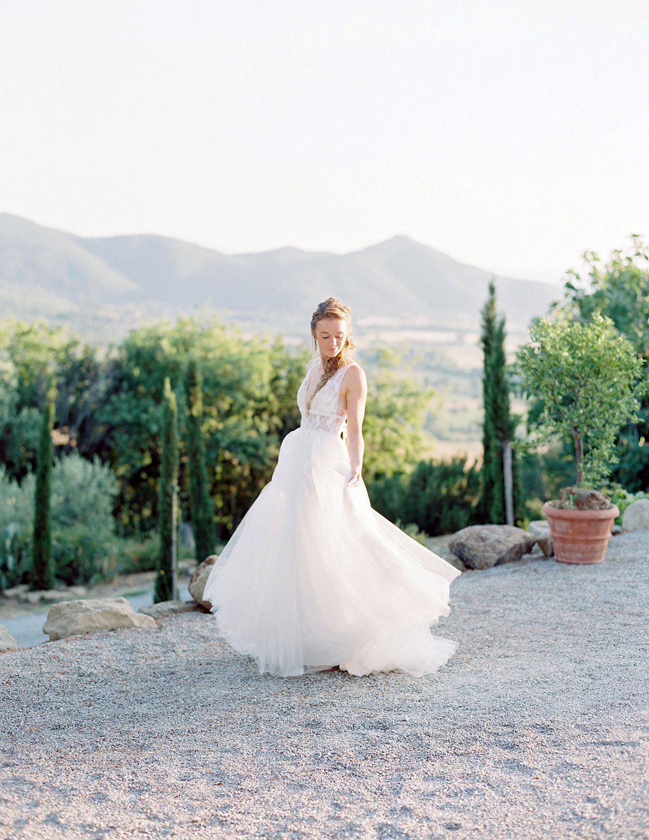 bride poses in wedding dress outdoor mountain view