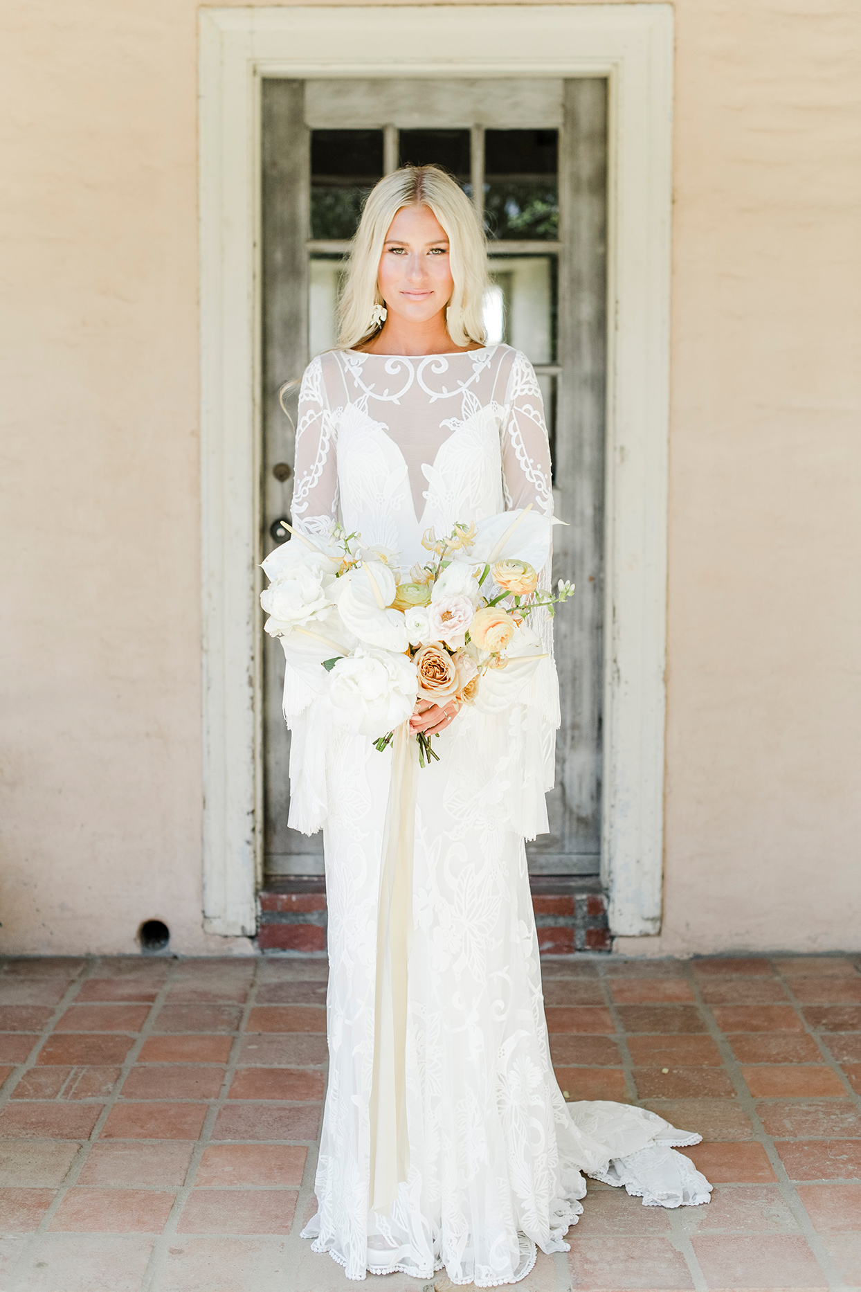 maddie will wedding bride in front of rustic door