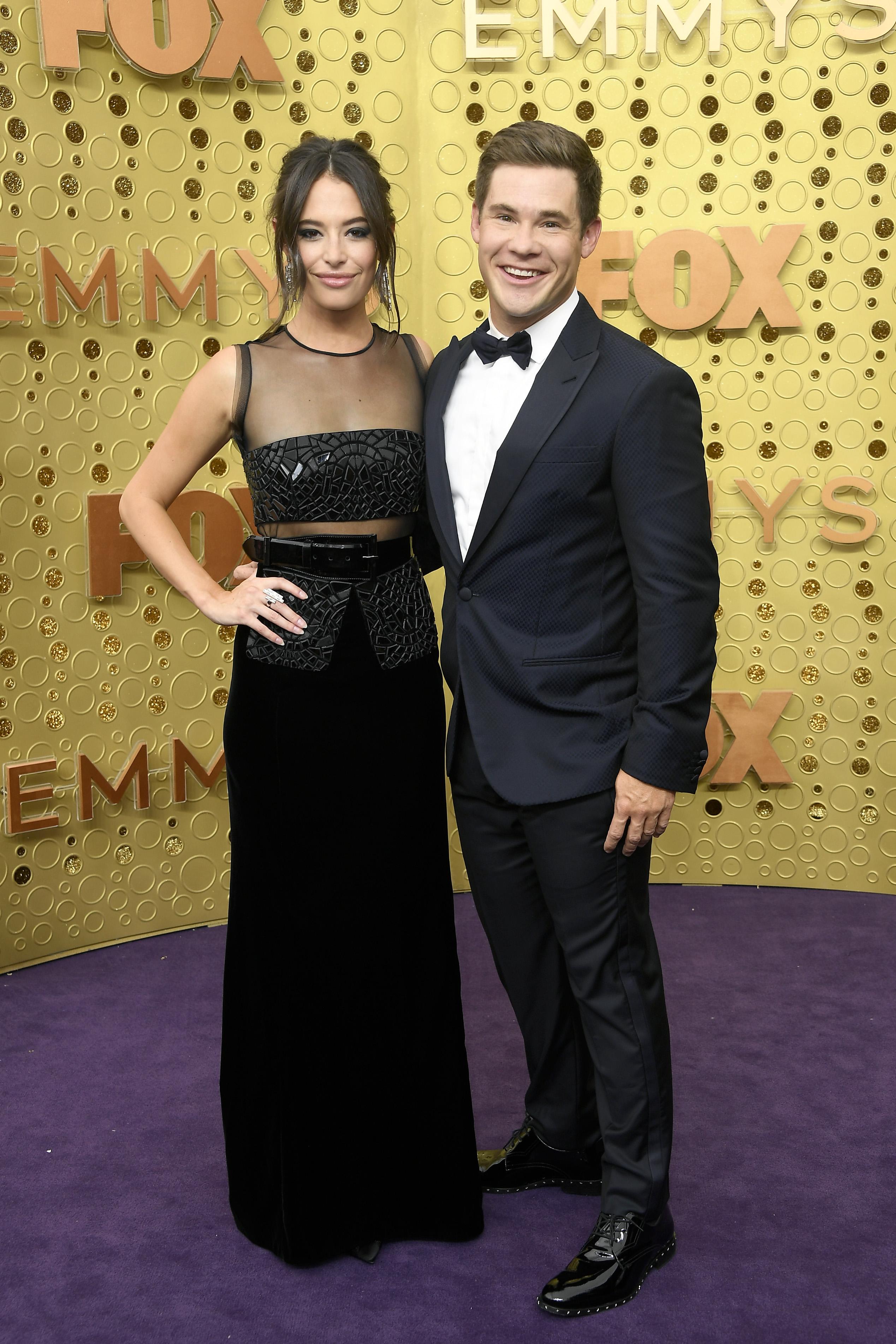 Adam Devine and Chloe Bridges at the Emmy awards.