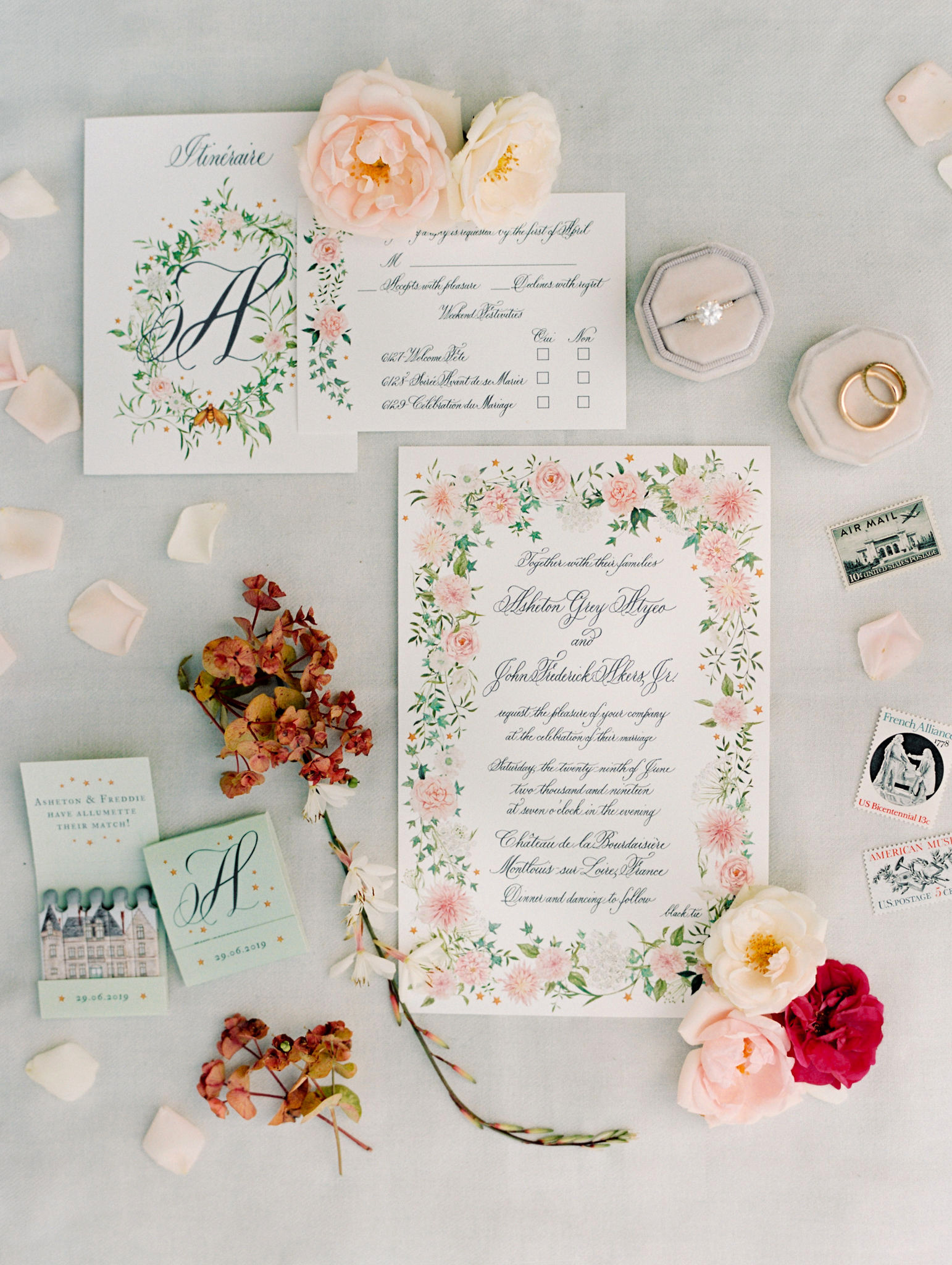wedding invites with rings stamps flowers and match books
