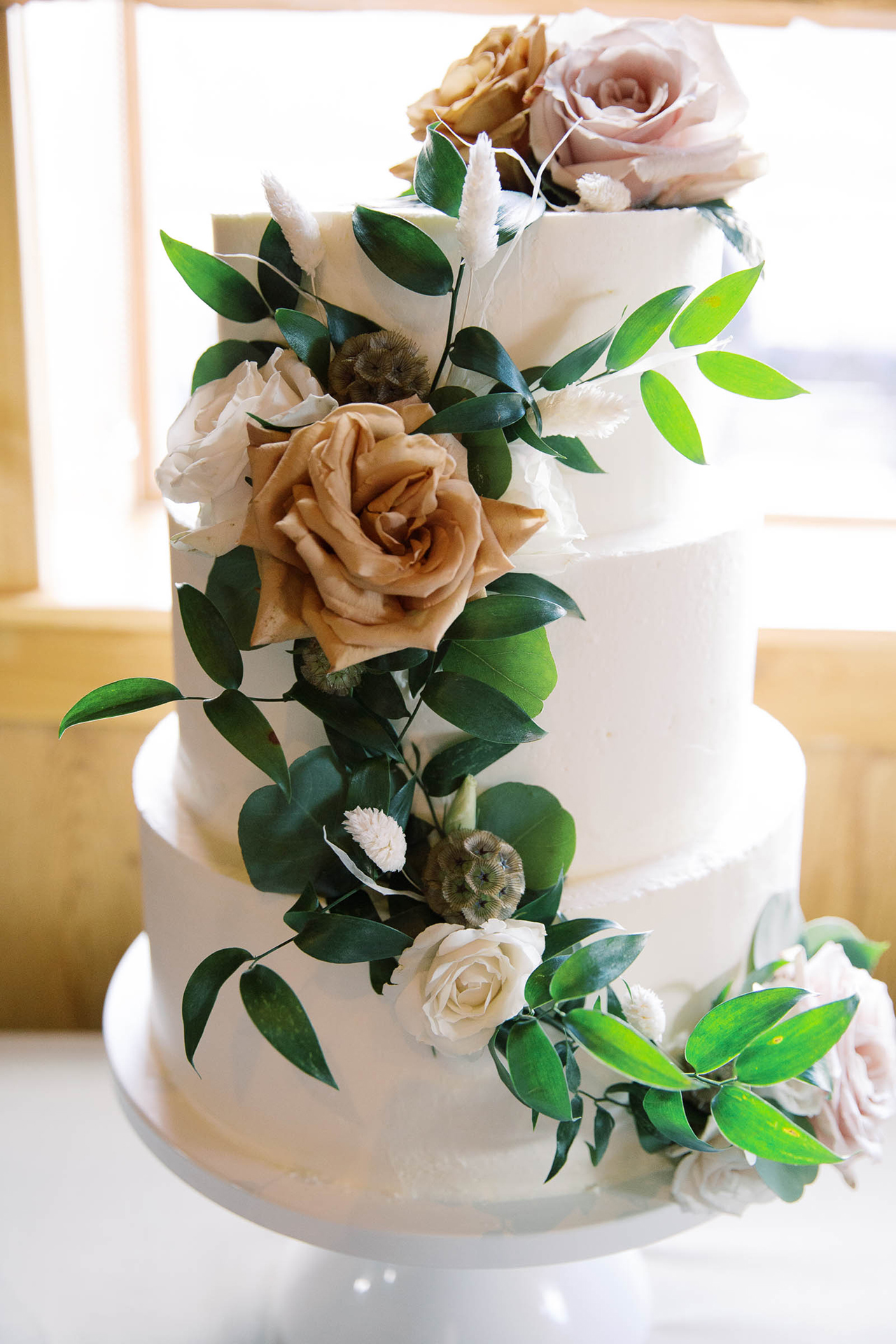 white ivory tiered almond cake floral decor