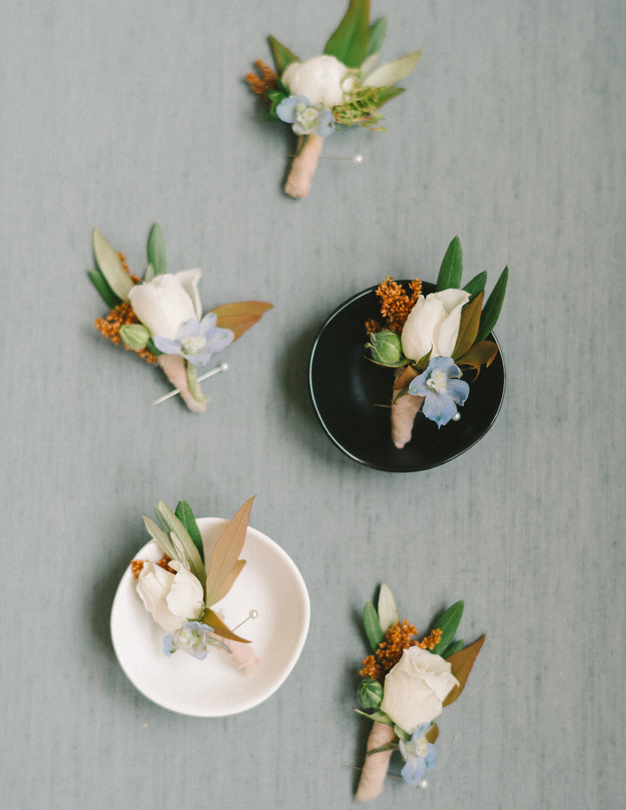 ericka meechaeyl wedding boutonnieres on decorative dishes