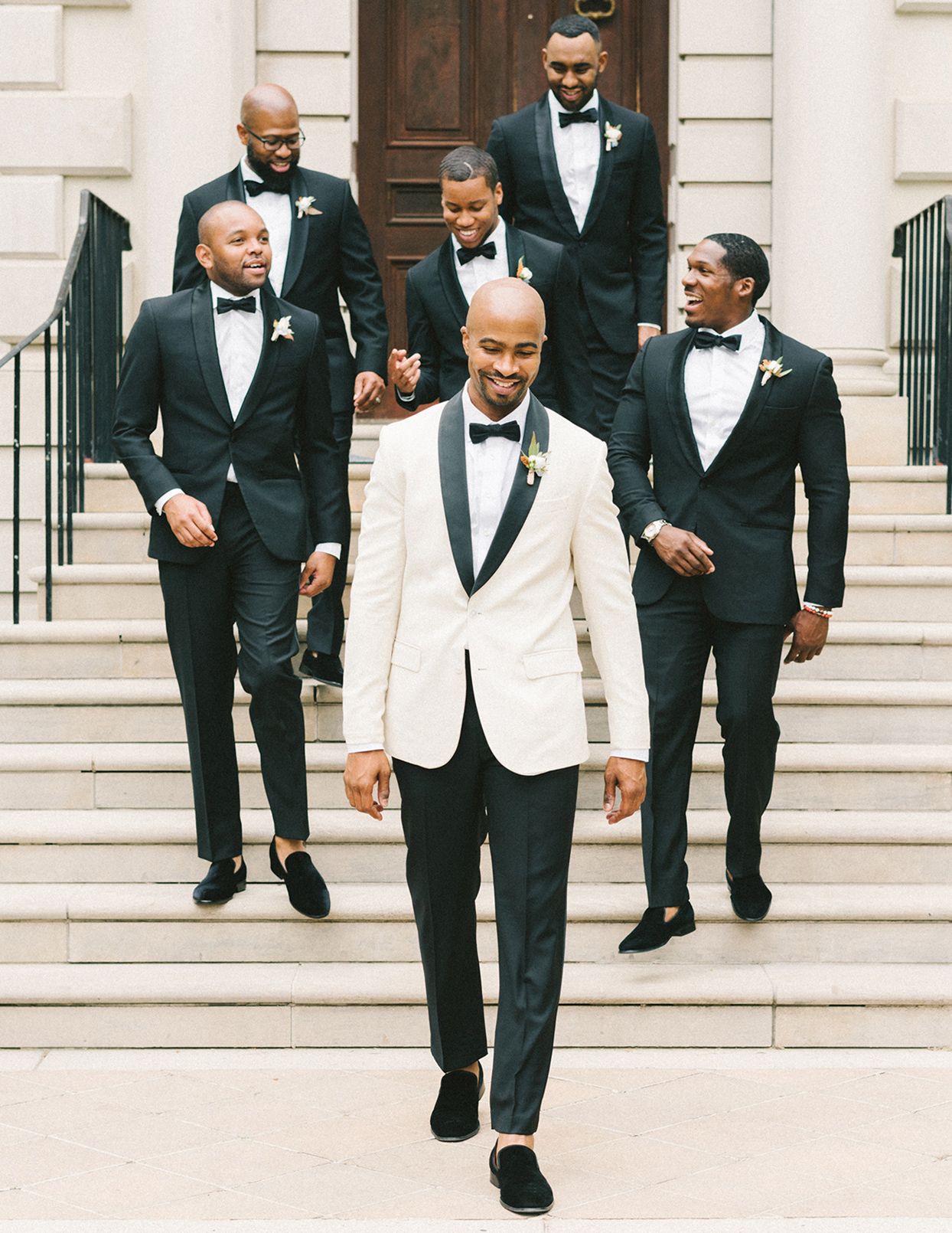 ericka meechaeyl wedding groomsmen walking down steps