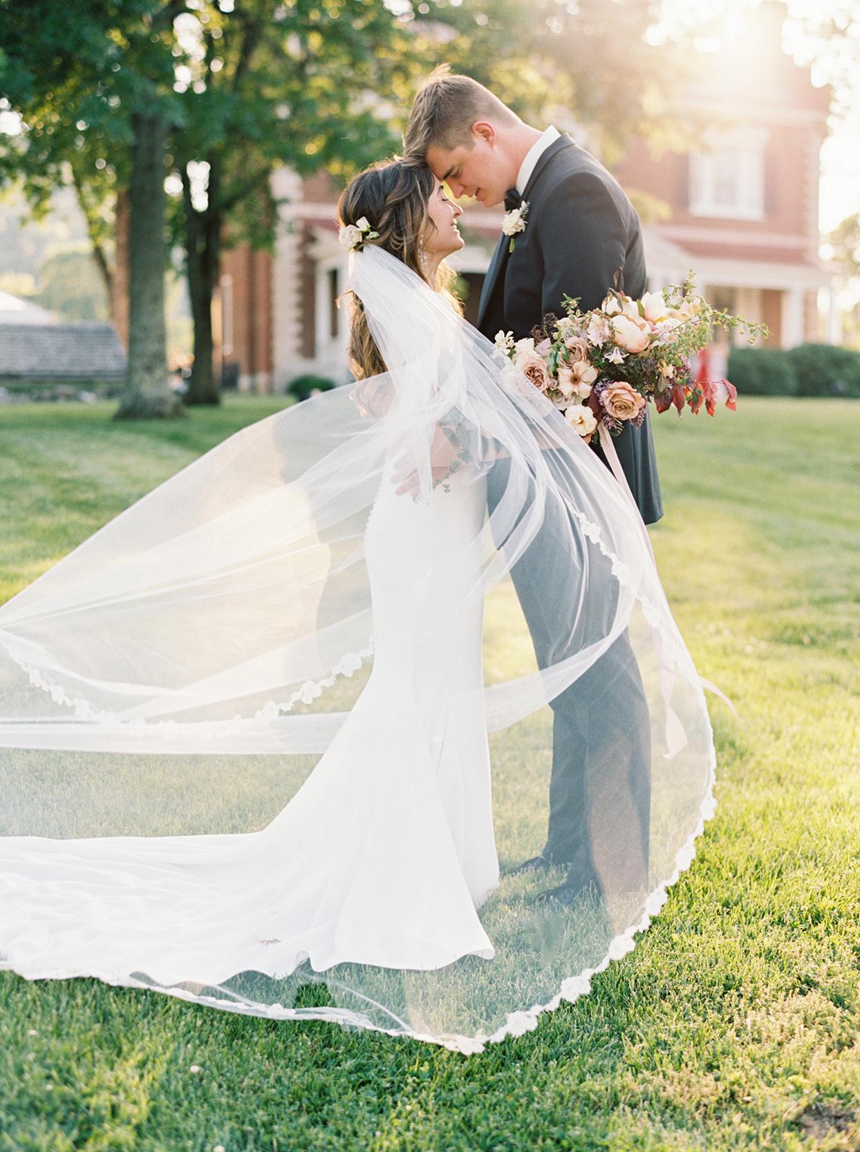 julia doug wedding couple veil blowing in wind