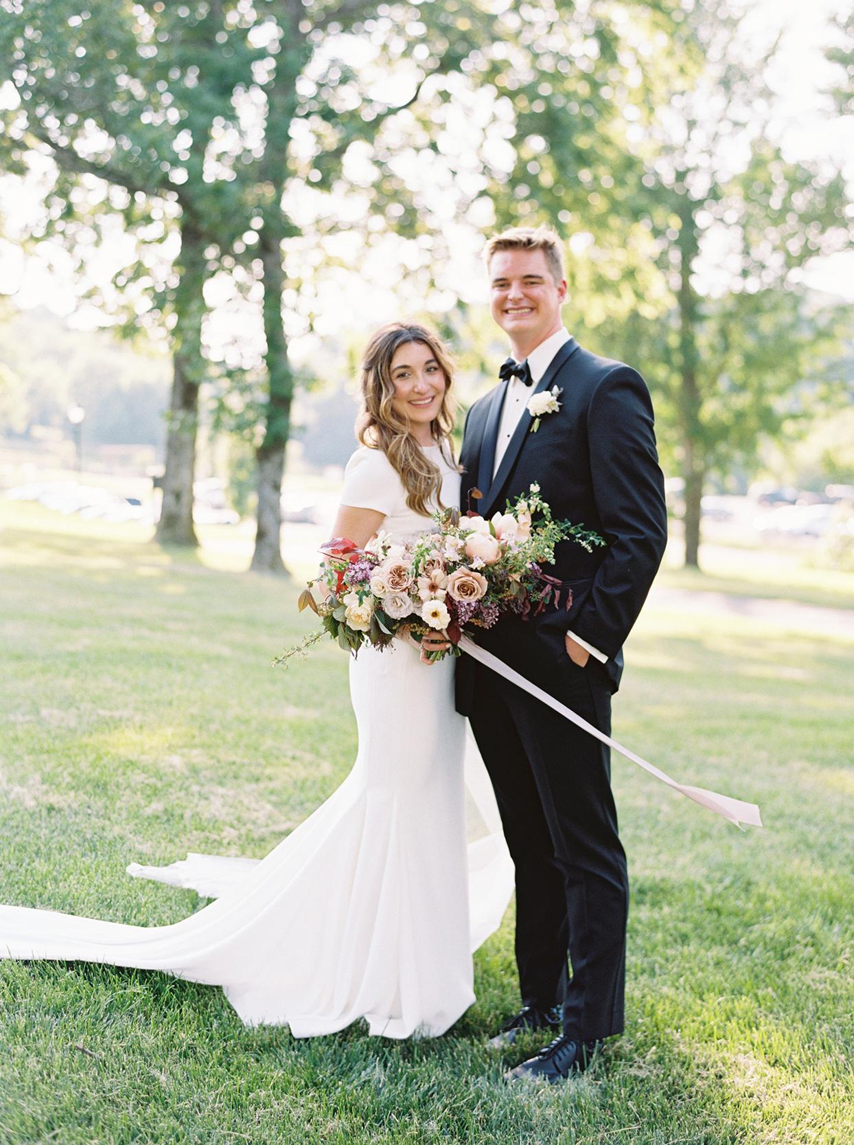 julia doug wedding couple in grass