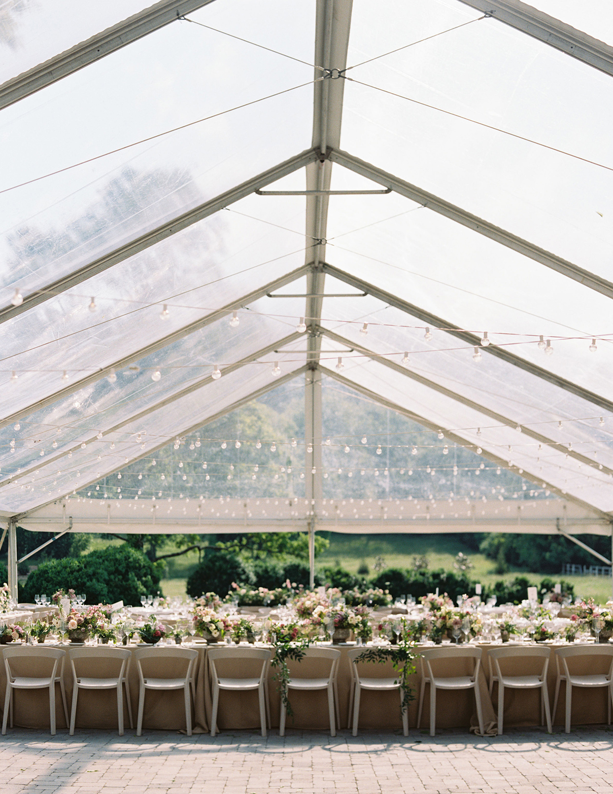 julia doug wedding reception tent with long tables