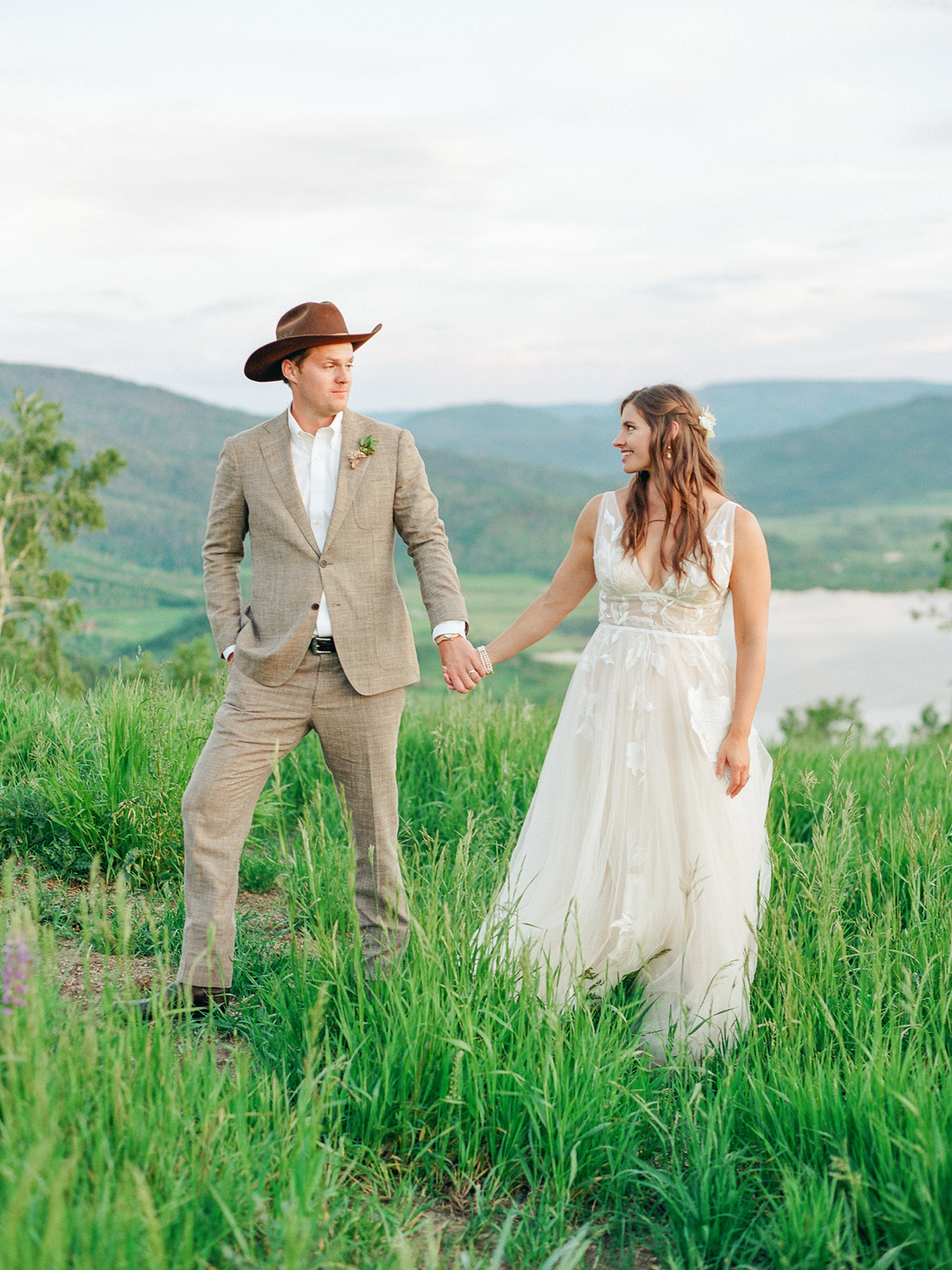 logan conor wedding couple holding hands