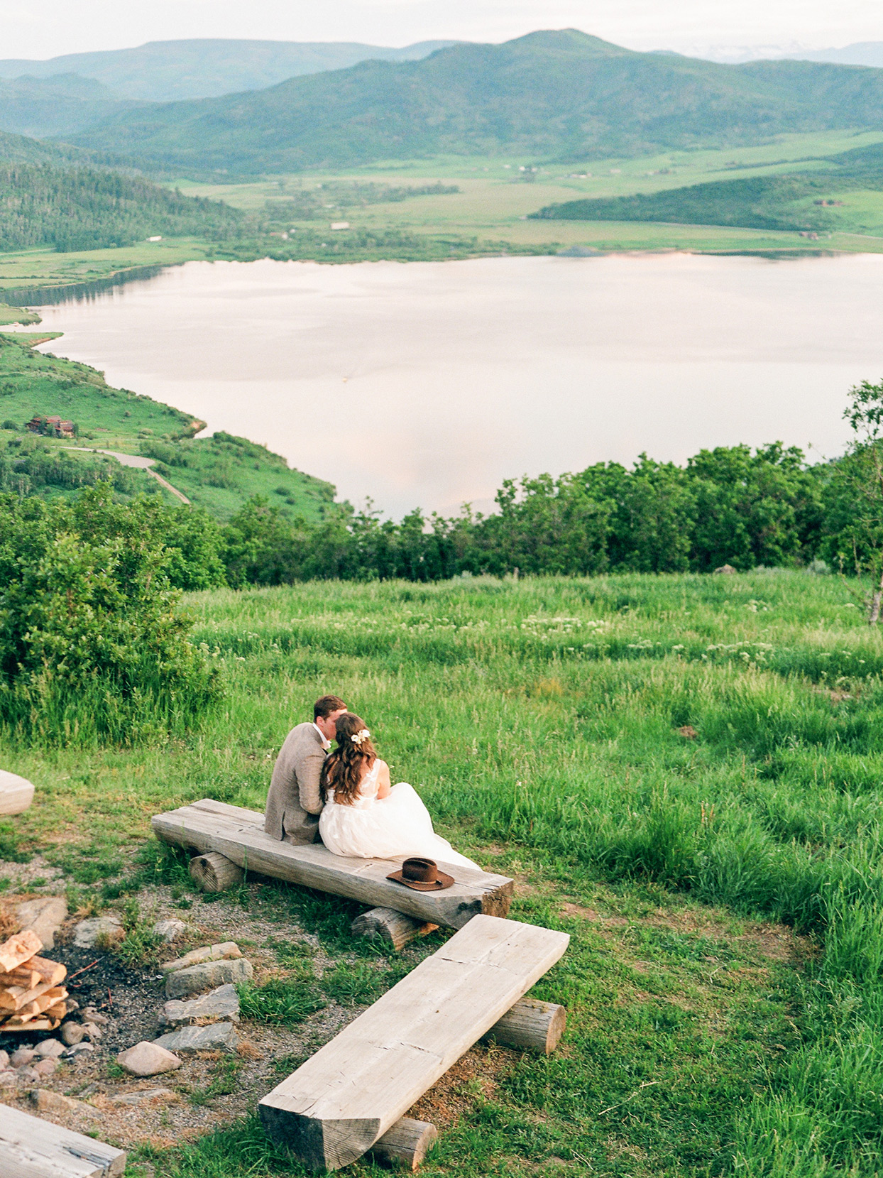 logan conor wedding couple sitting on bench overlooking mountains