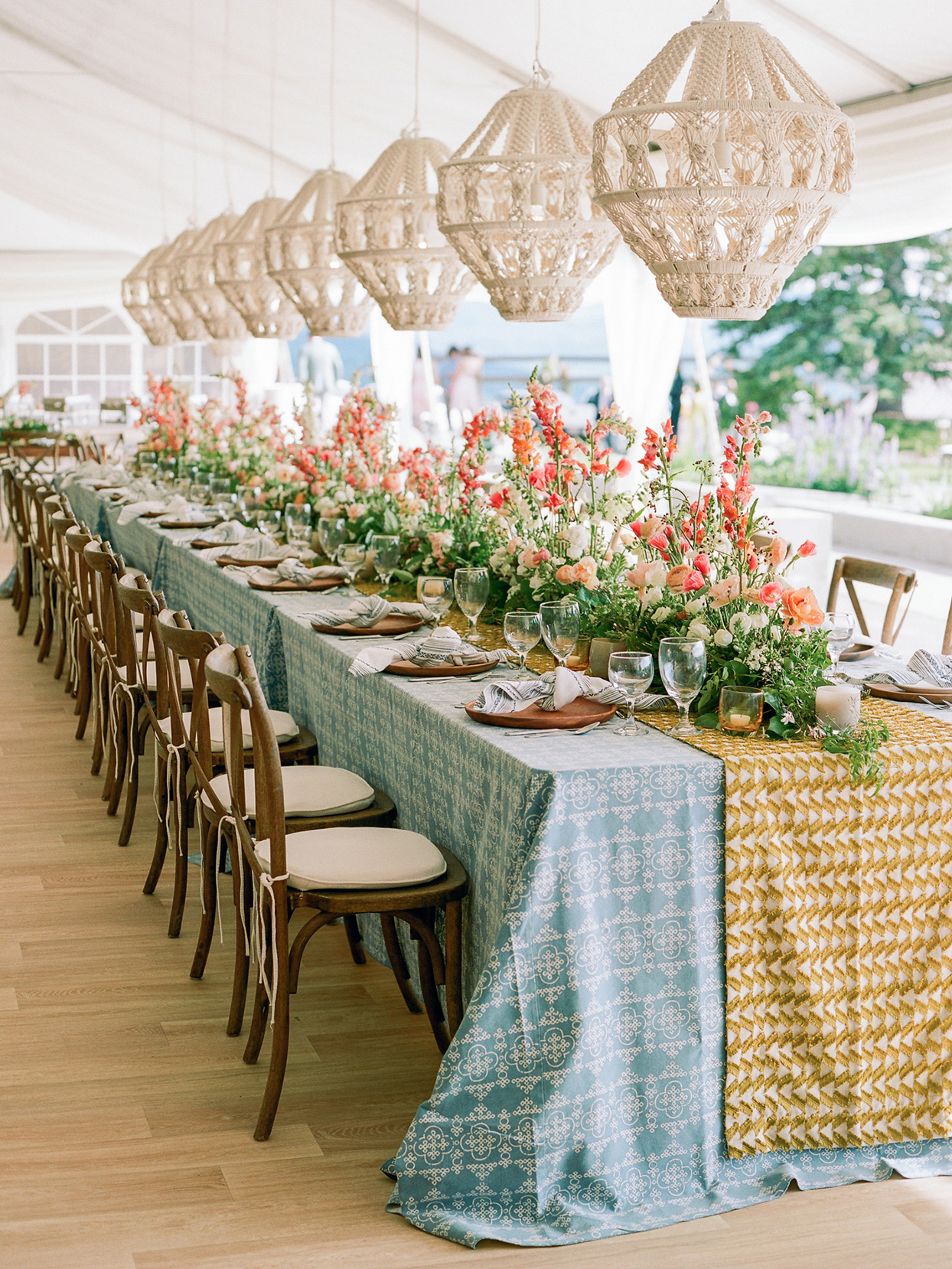 logan conor wedding colorful reception tables with hanging wicker lights