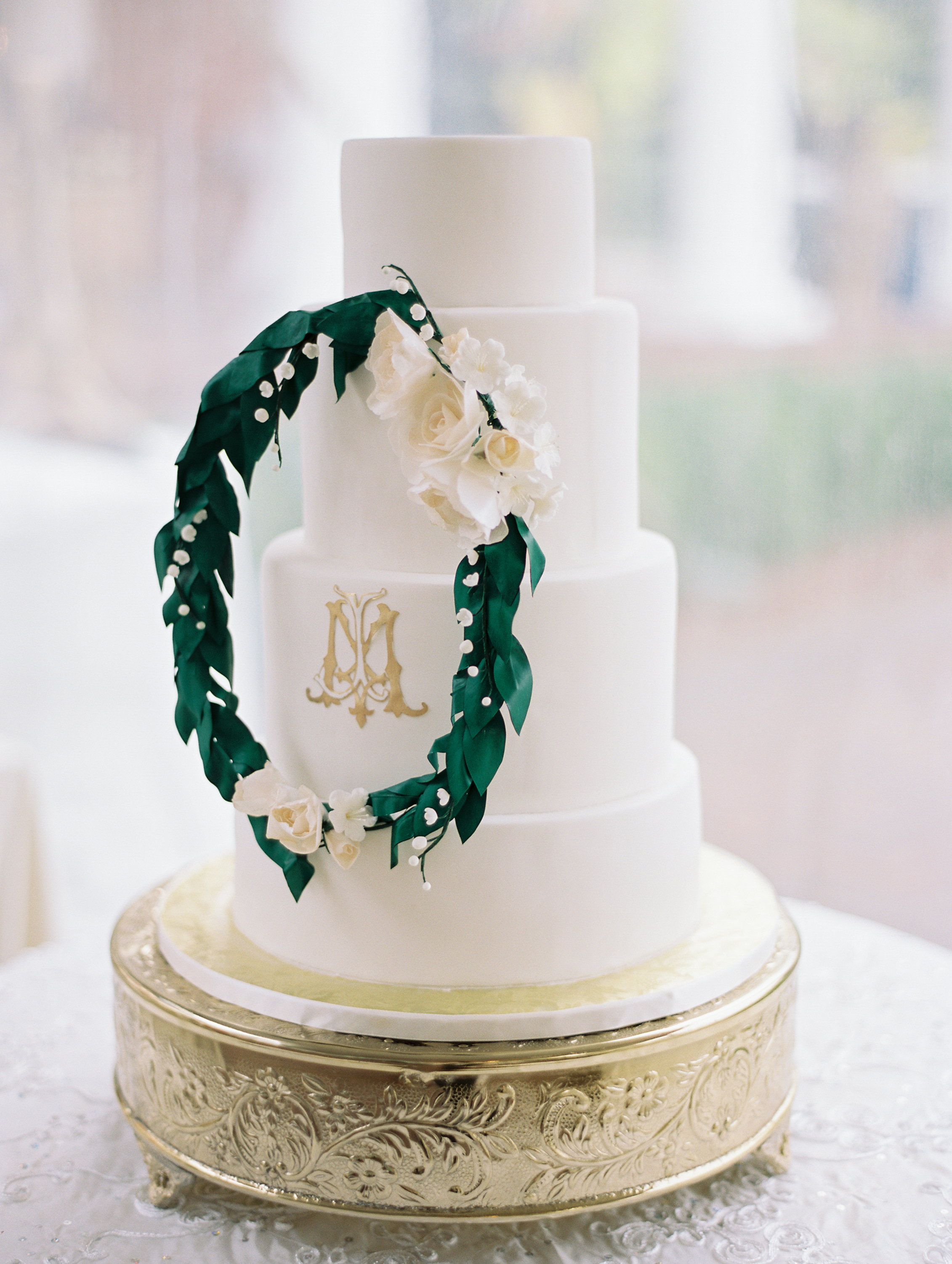 macey joshua wedding cake with wreath