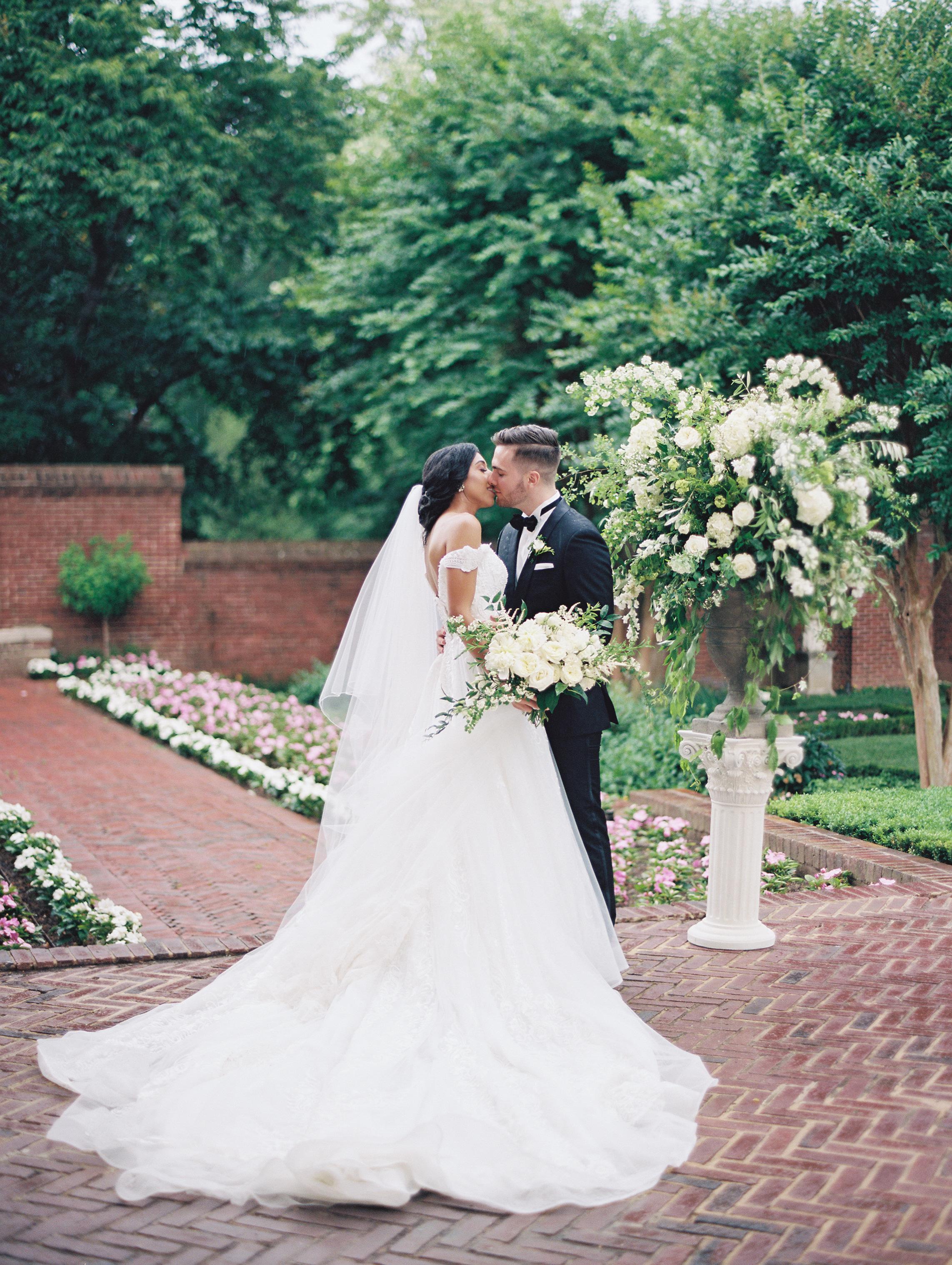 macey joshua wedding couple kissing in garden