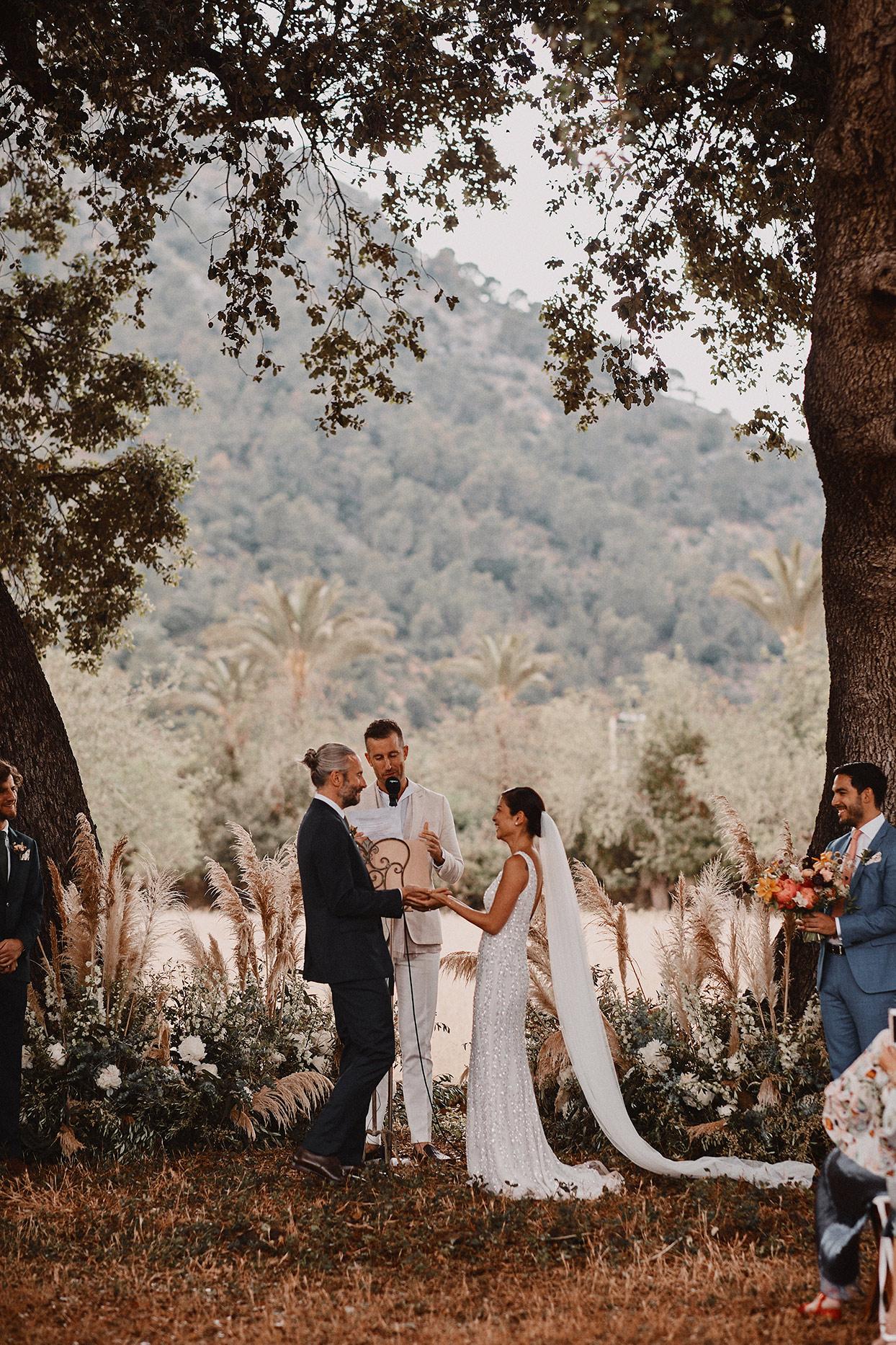 pomme daniel wedding ceremony under trees
