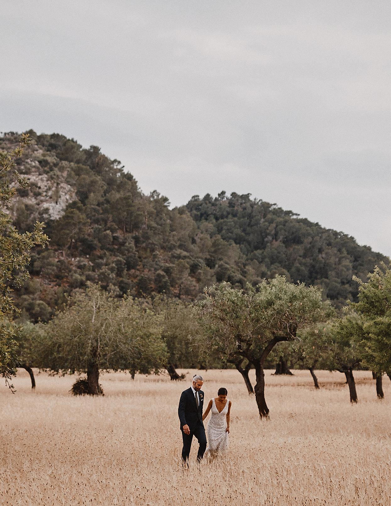 pomme daniel wedding couple walking through field