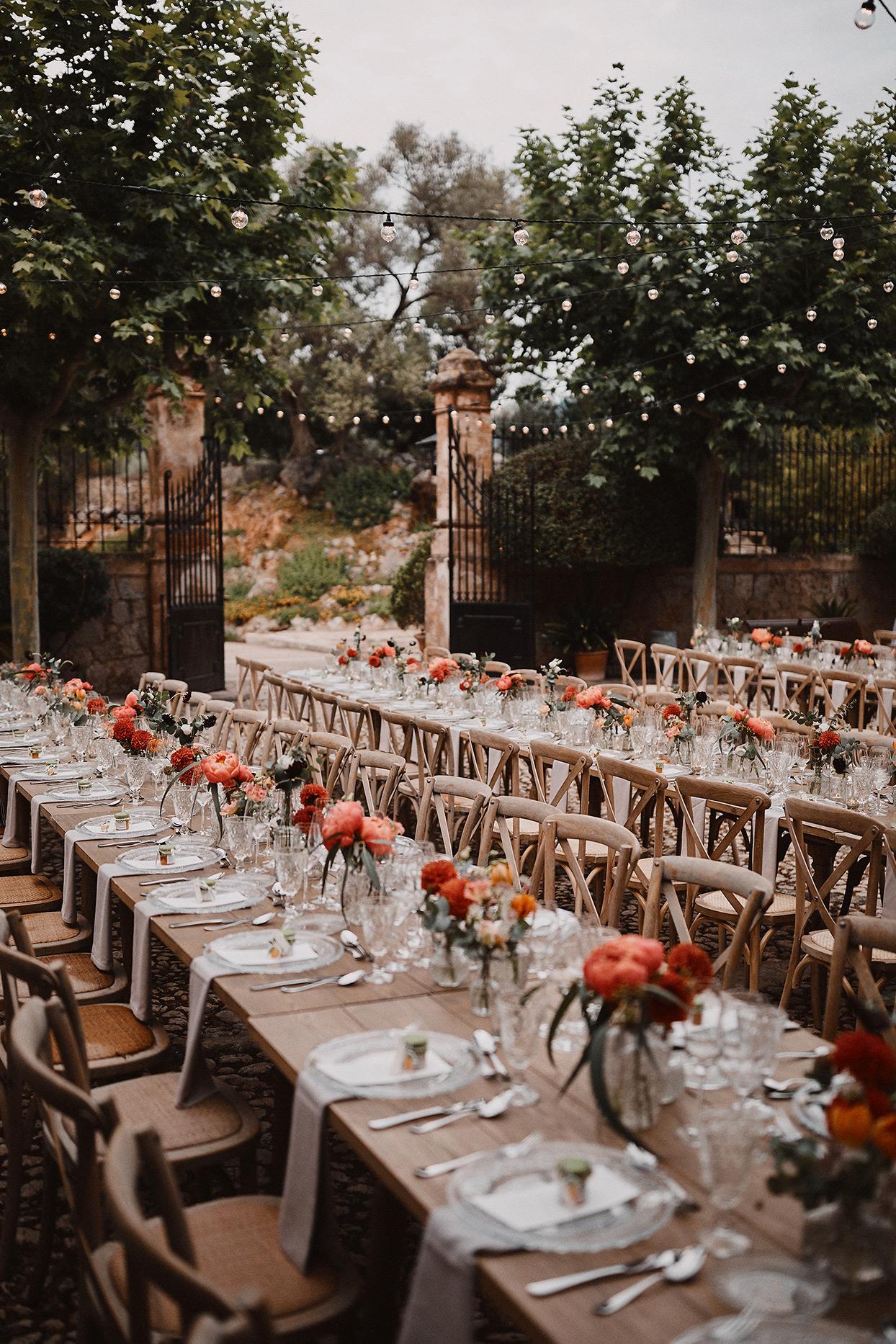 pomme daniel wedding reception long wooden tables
