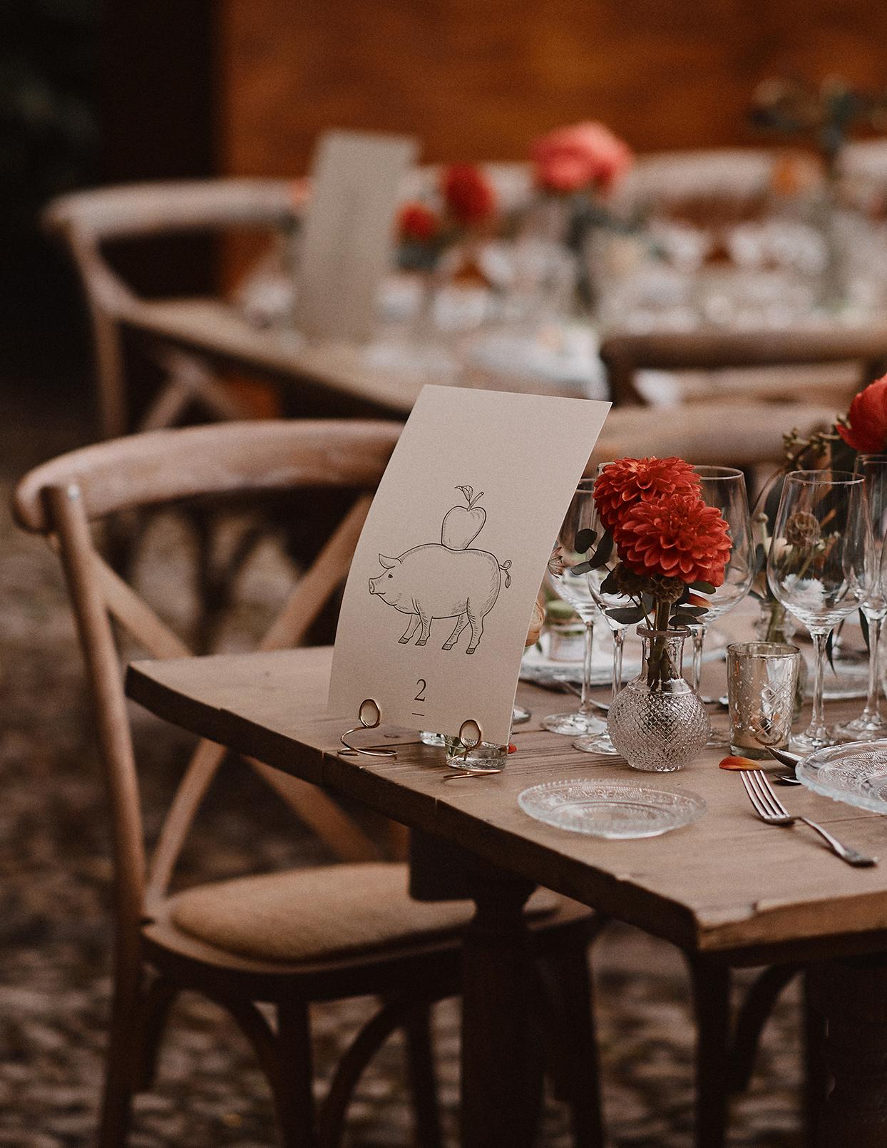 pomme daniel wedding reception pig illustration table numbers