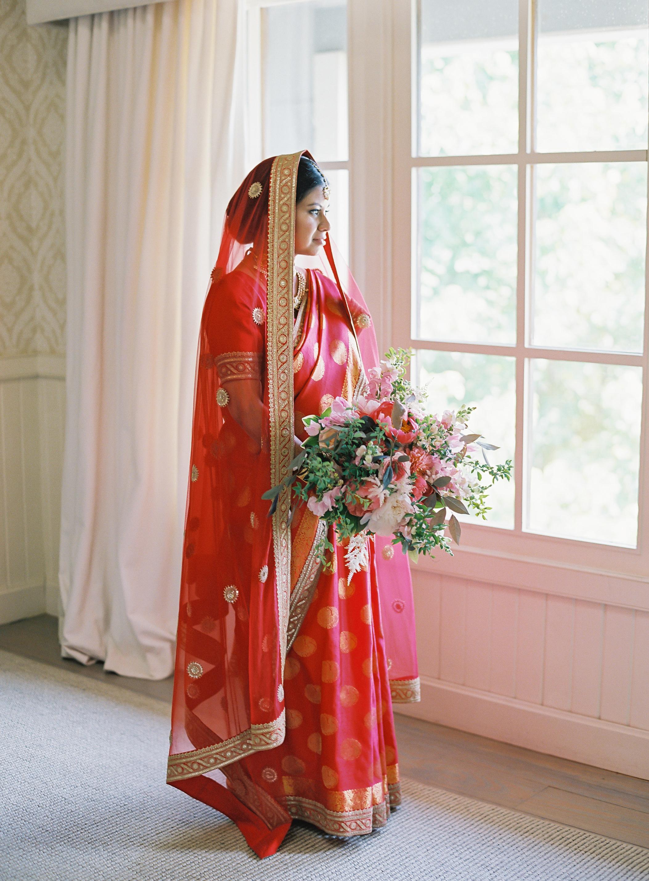 ronita ryan wedding bride gazing out of window in veil