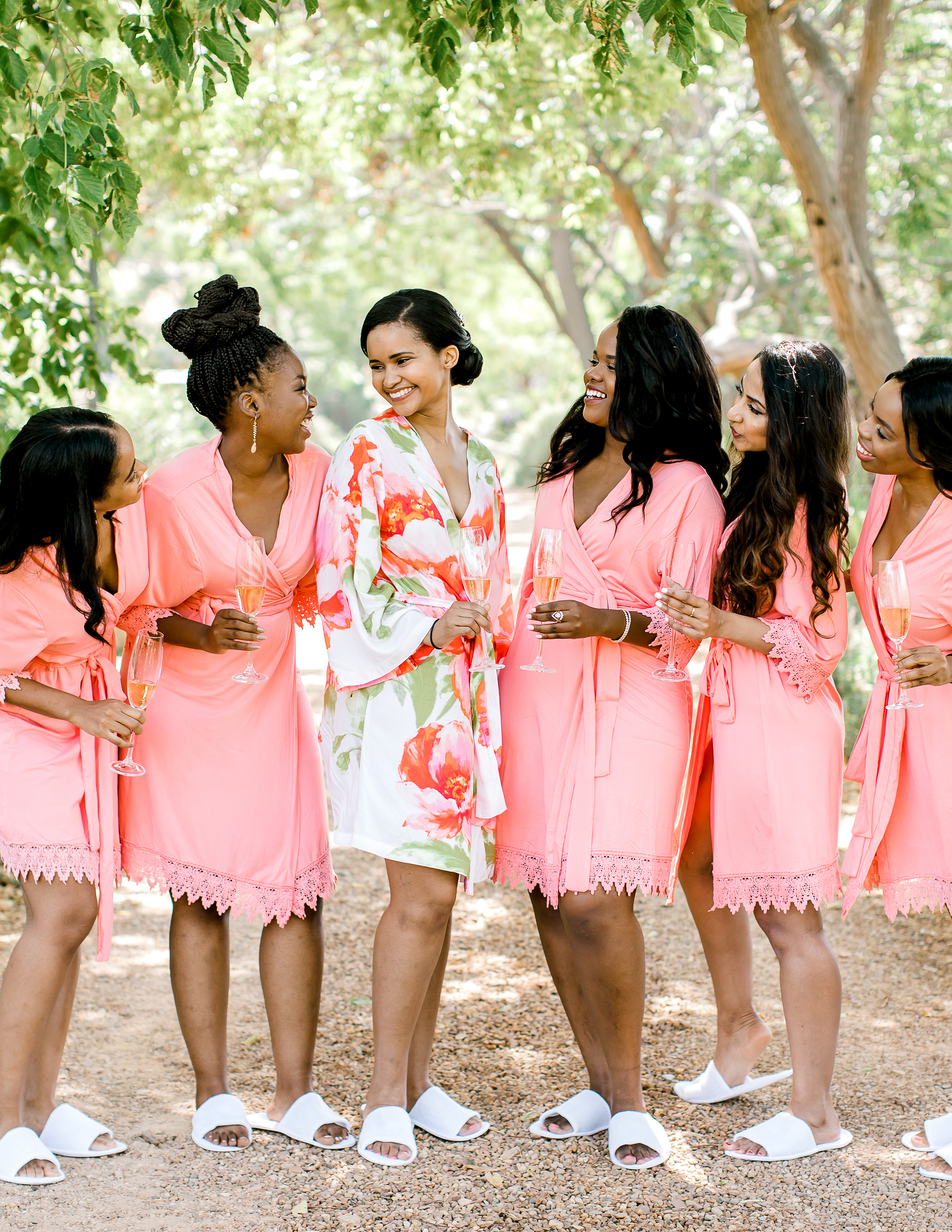 rorisang stephen bride getting ready with bridesmaids in robes