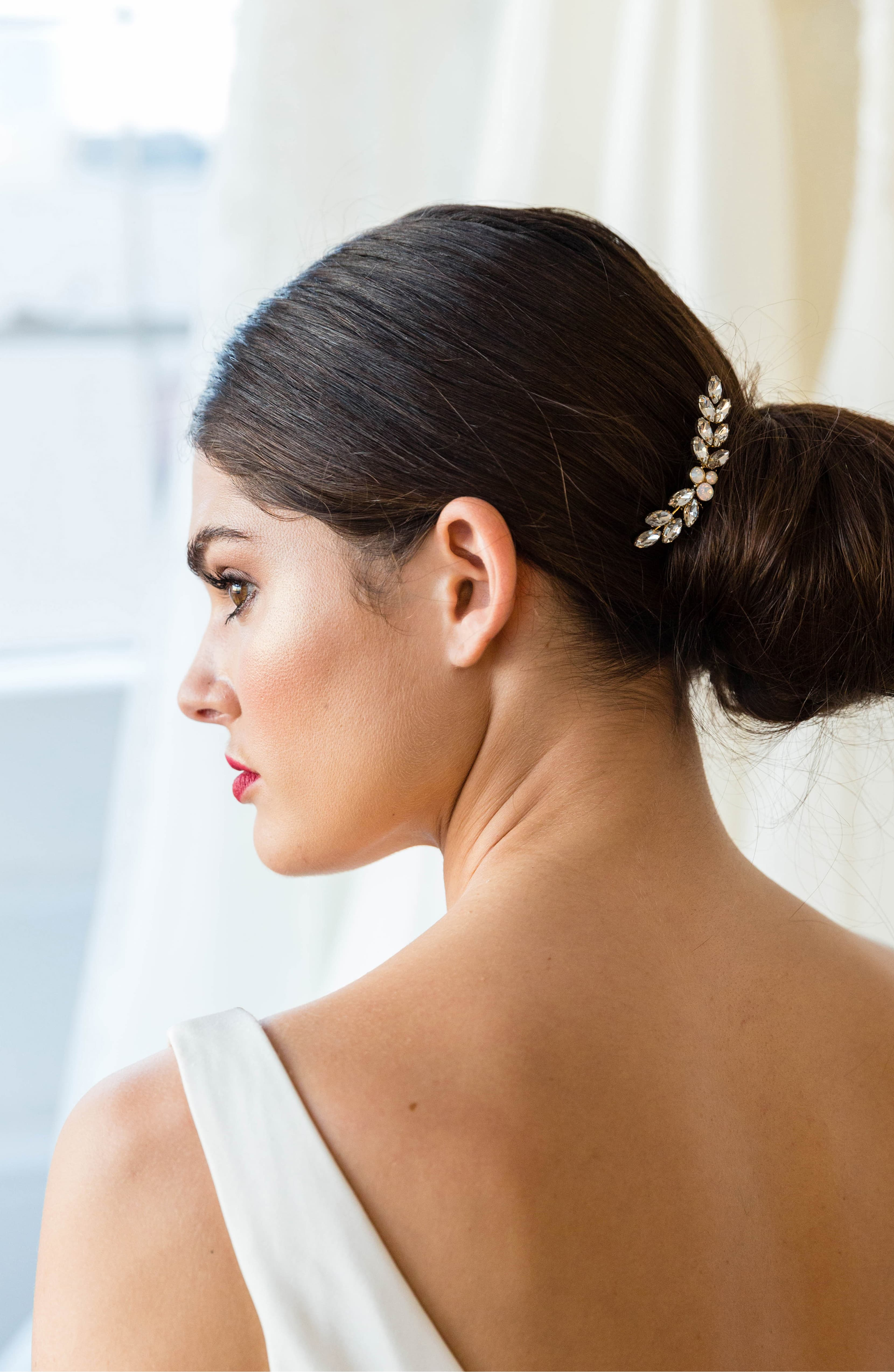 dark brown haired woman wearing Amber Comb with bun