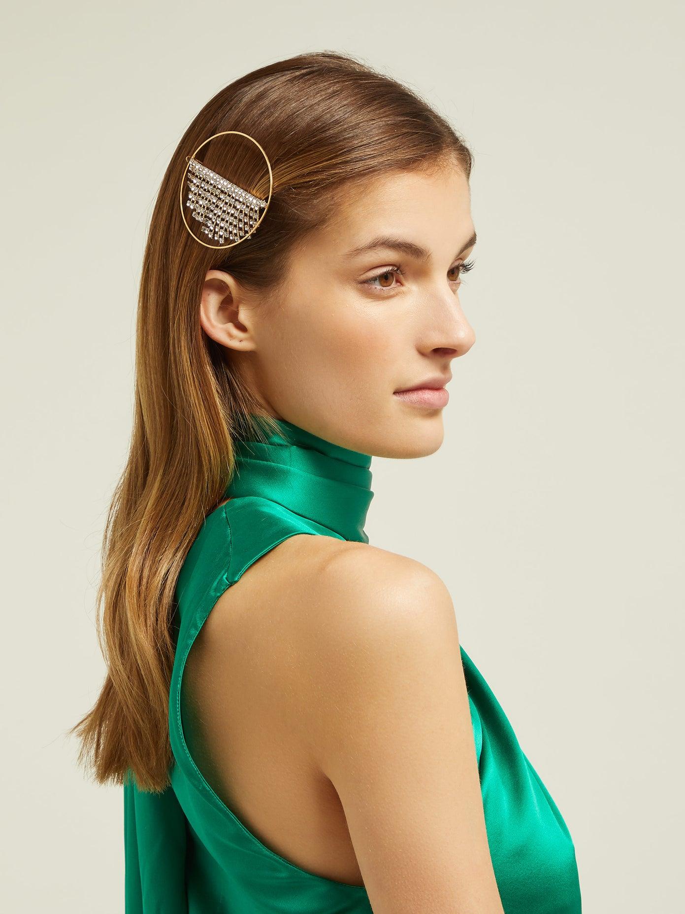light brown-haired woman wearing Rosantica hair clip