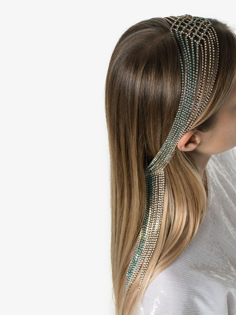 side view of woman wearing Luci headband