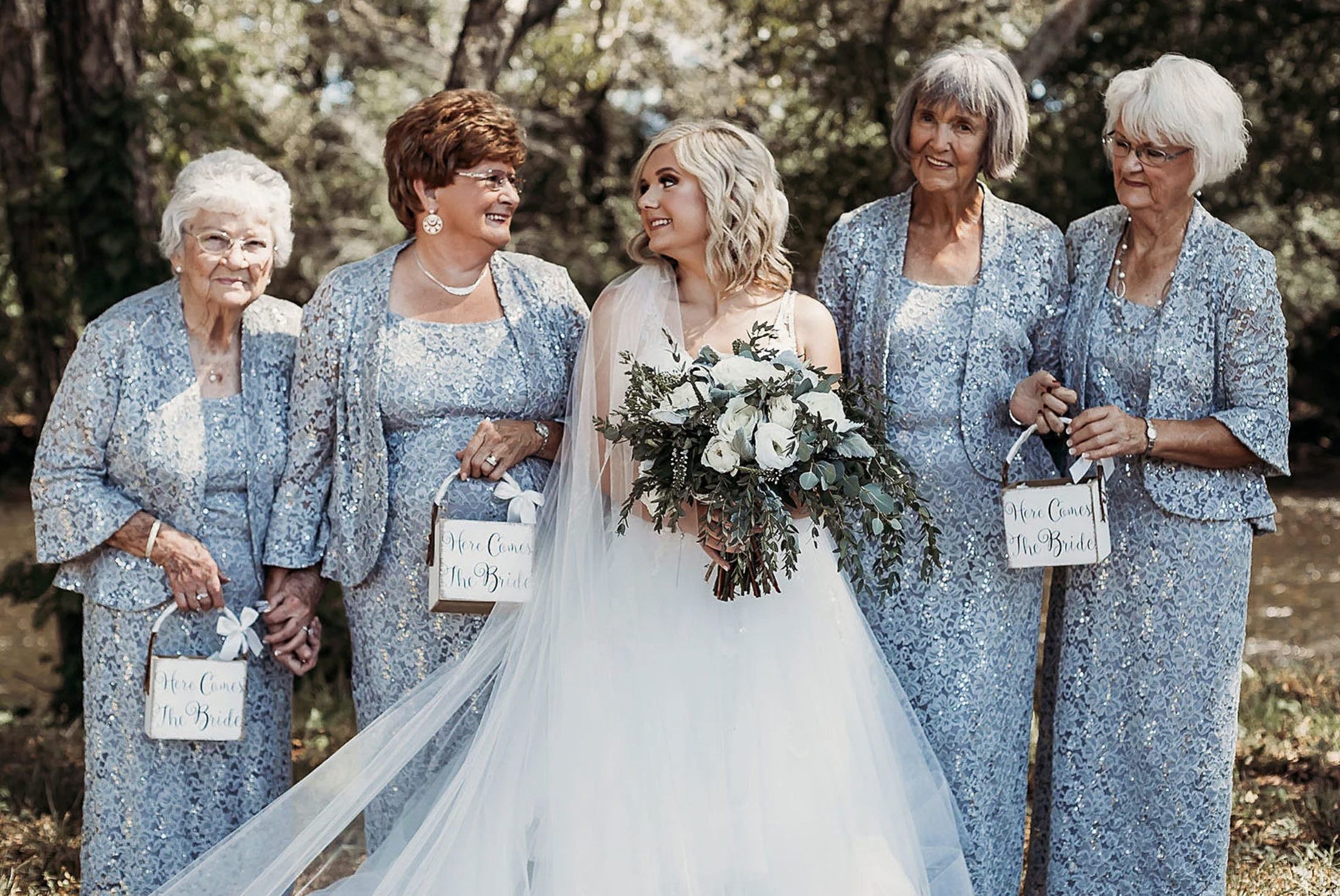 bride with four grandmothers as flower girls