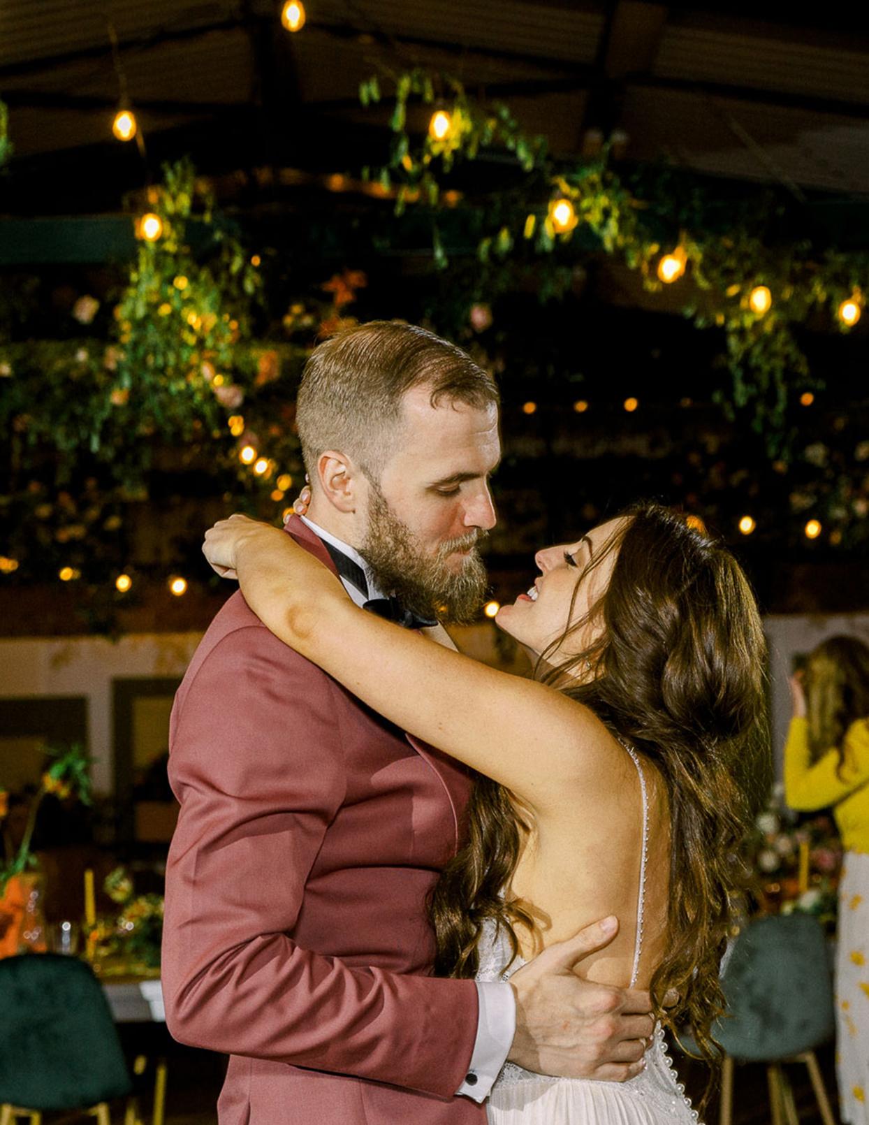bride and groom dancing smiling