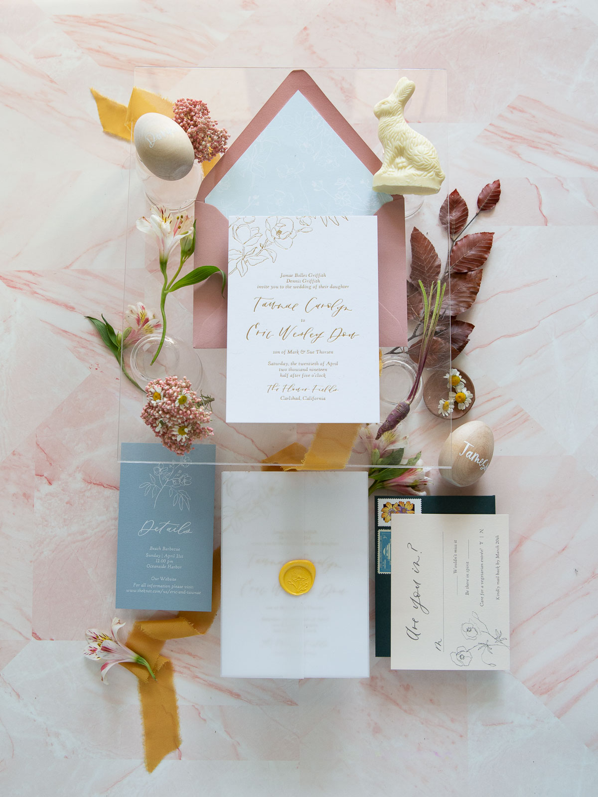pastel blue and pink with yellow accent wedding stationery
