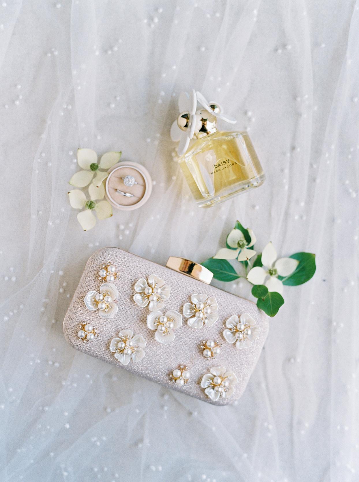 thuy kahn wedding clutch, rings, perfume