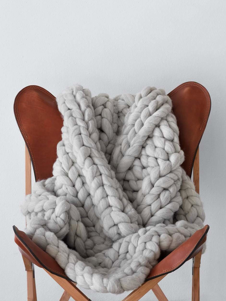 knotted blanket on folding chair