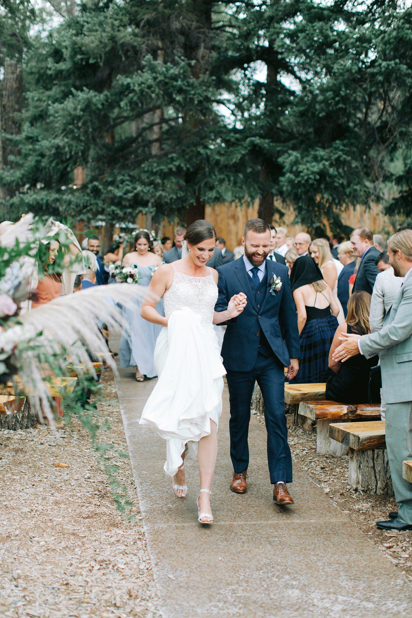 Casey Andrew Wedding Ceremony Recessional Rain Couple