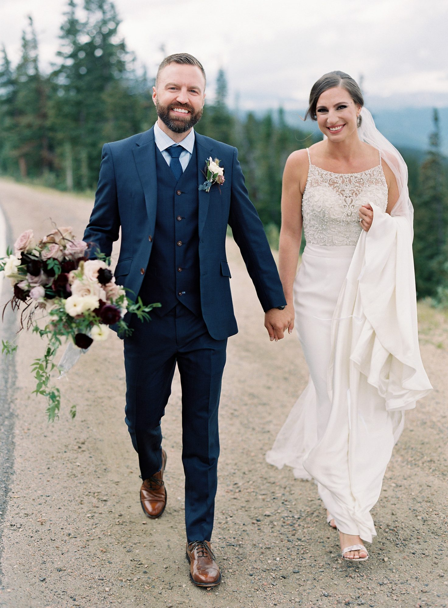Casey Andrew Wedding Couple Holding Hands and Walking