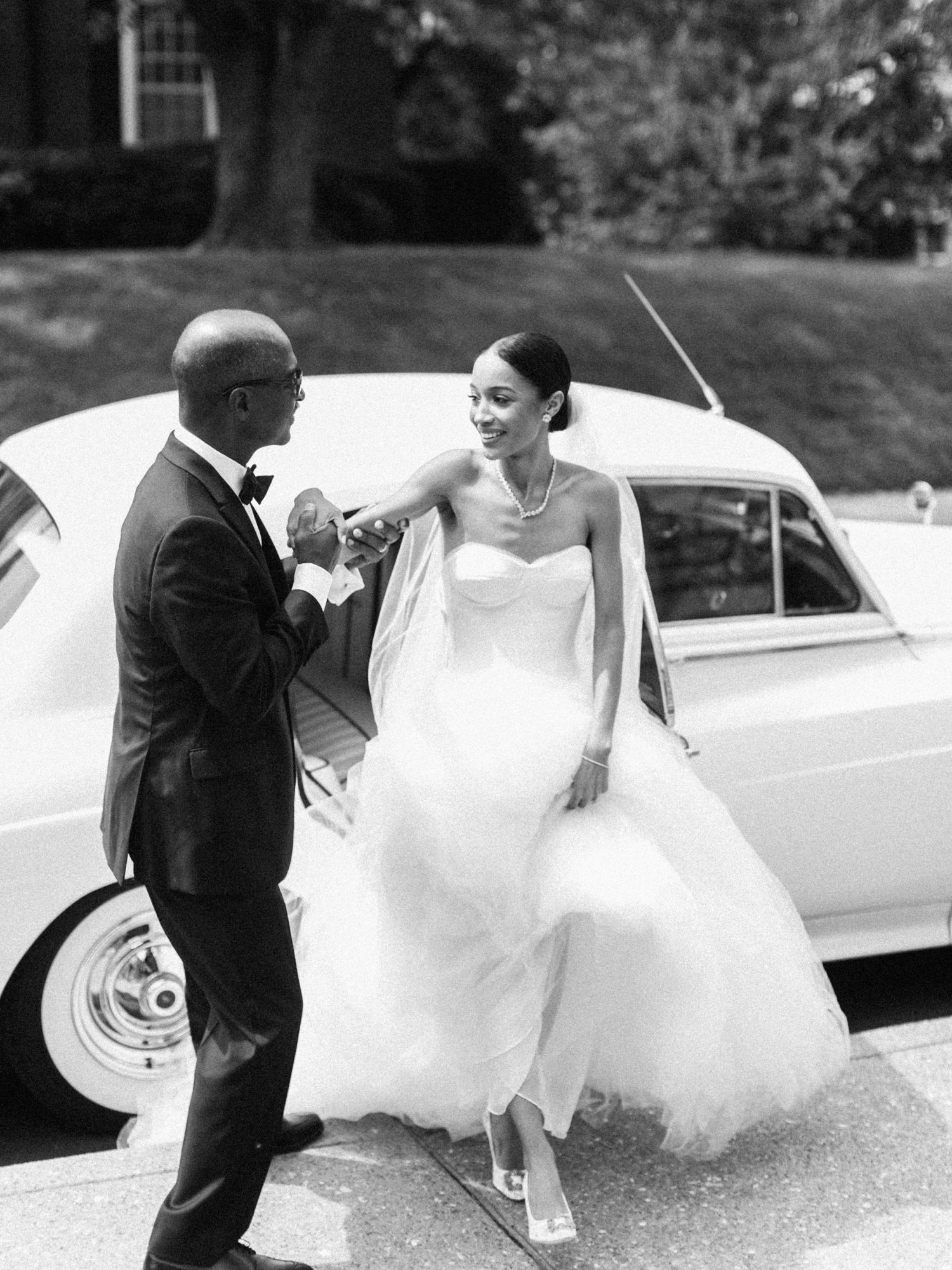 erinn andrew wedding bride father step out of vintage car