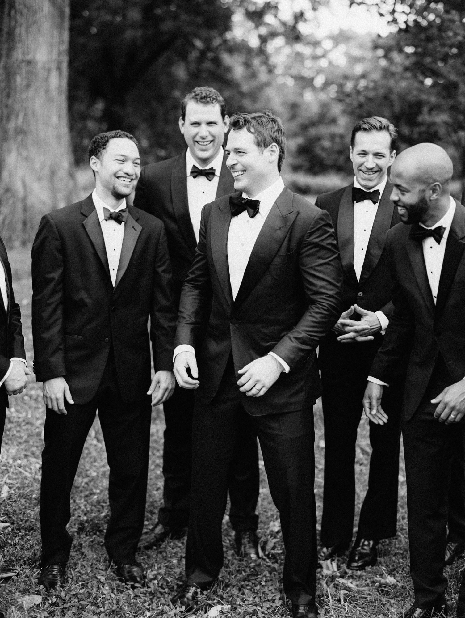erinn andrew groom groomsmen outdoor portrait
