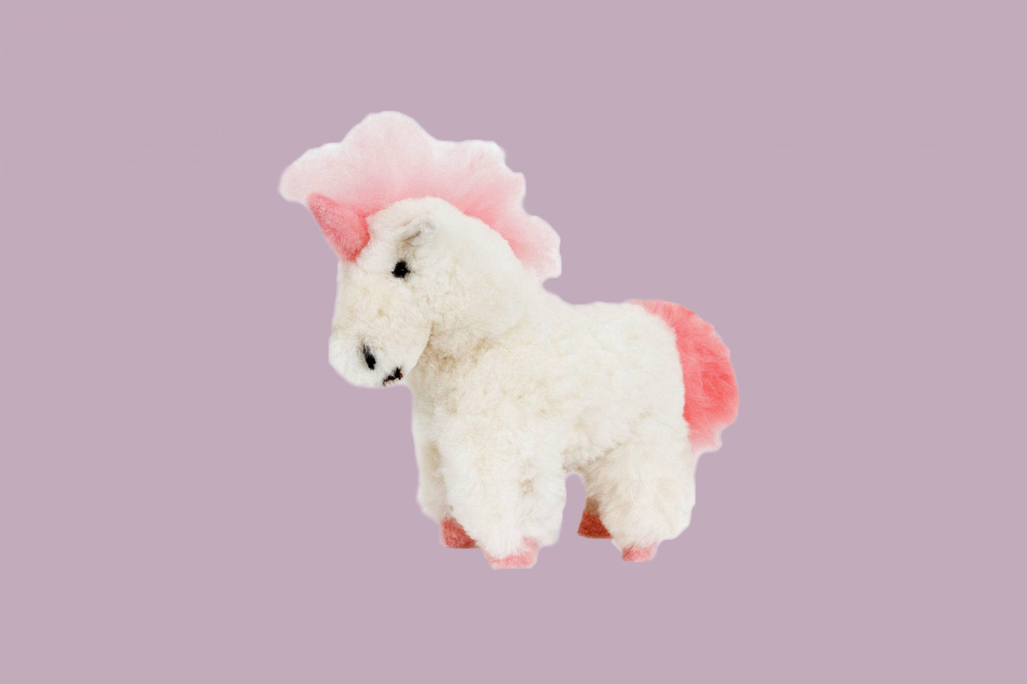 pink and white plush unicorn