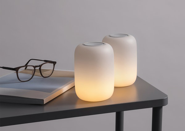 two casper glow lights on side table
