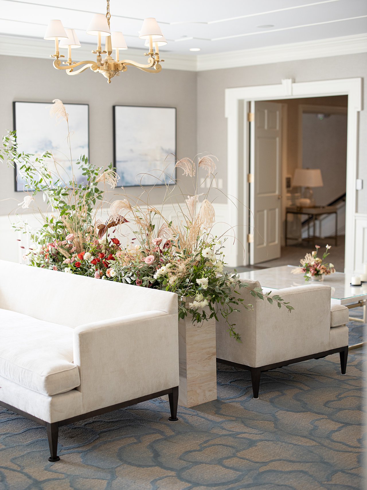 tall floral arrangement guest couches