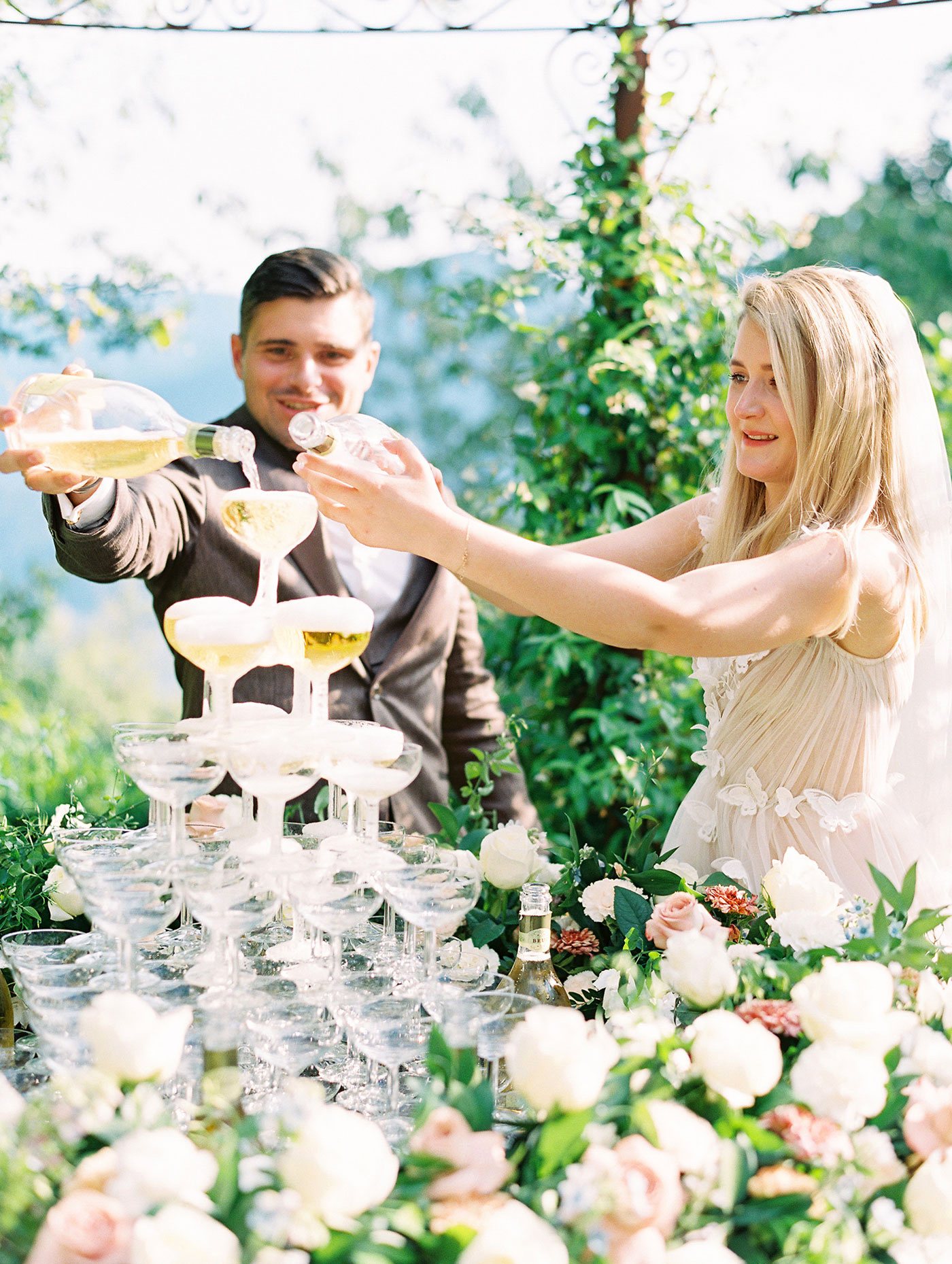 julia franz wedding champagne tower couple