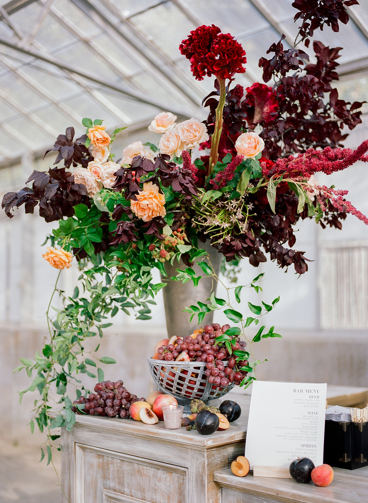 burgundy centric foliage fruit reception decor