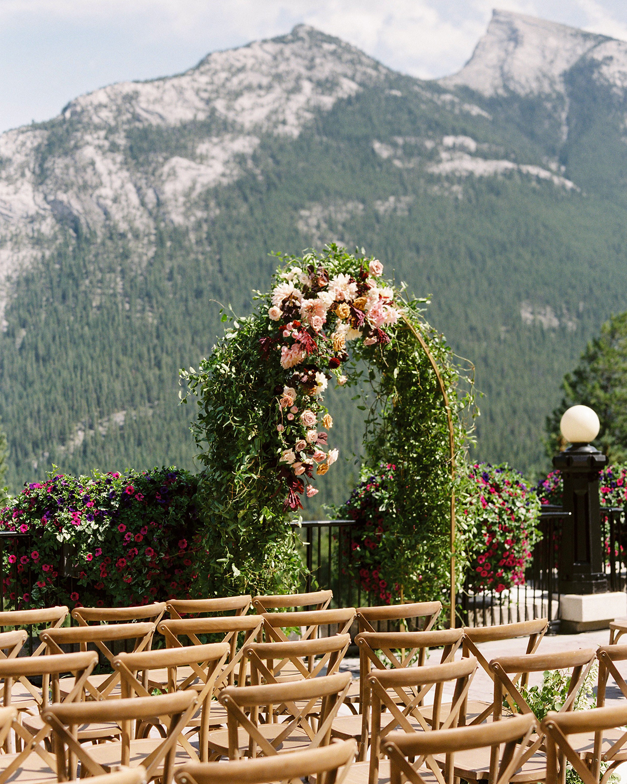 katie nicholas wedding arch with mountain backdrop