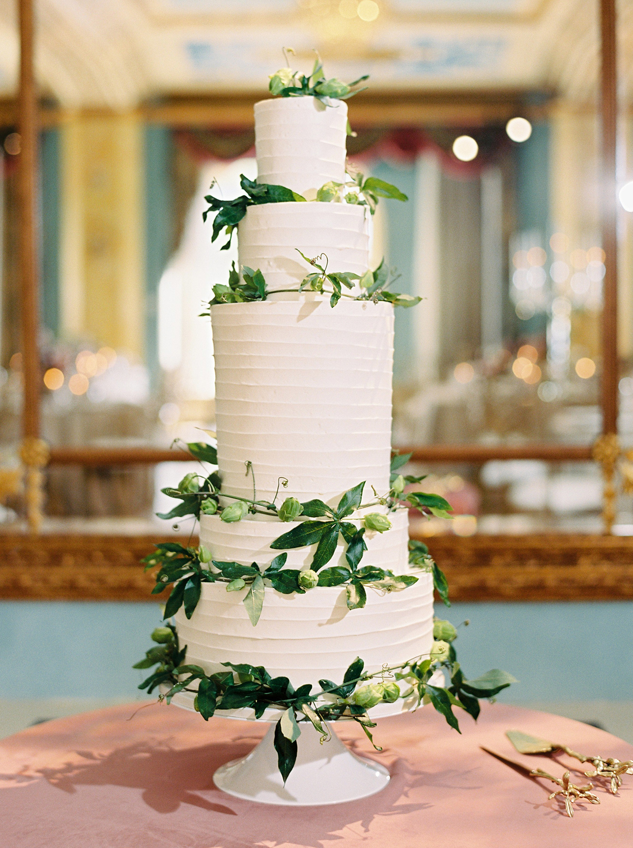 katie nicholas wedding cake with greenery